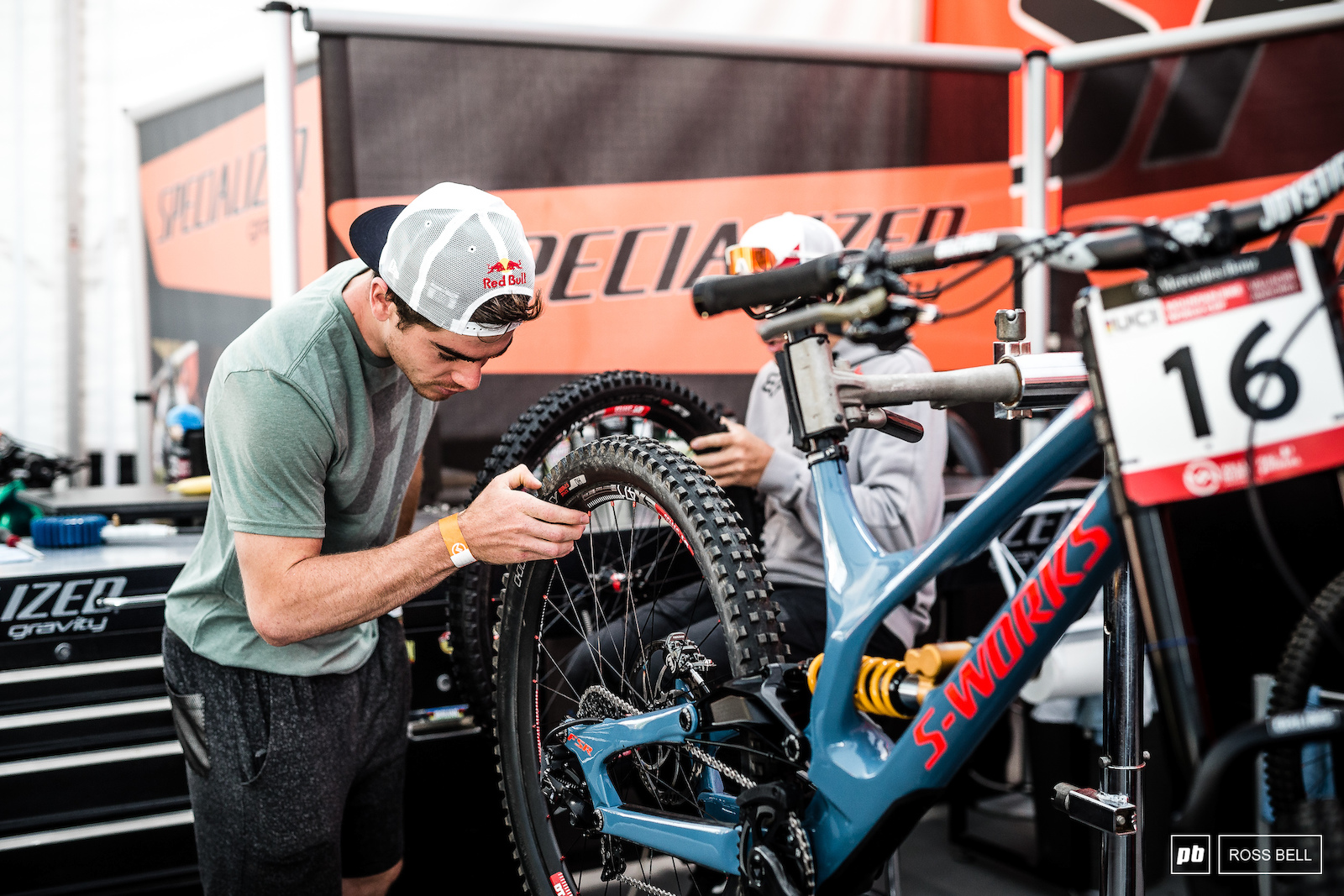 Loic Bruni inspecting his bike that mechanic Jack Roure meticulously prepared overnight.