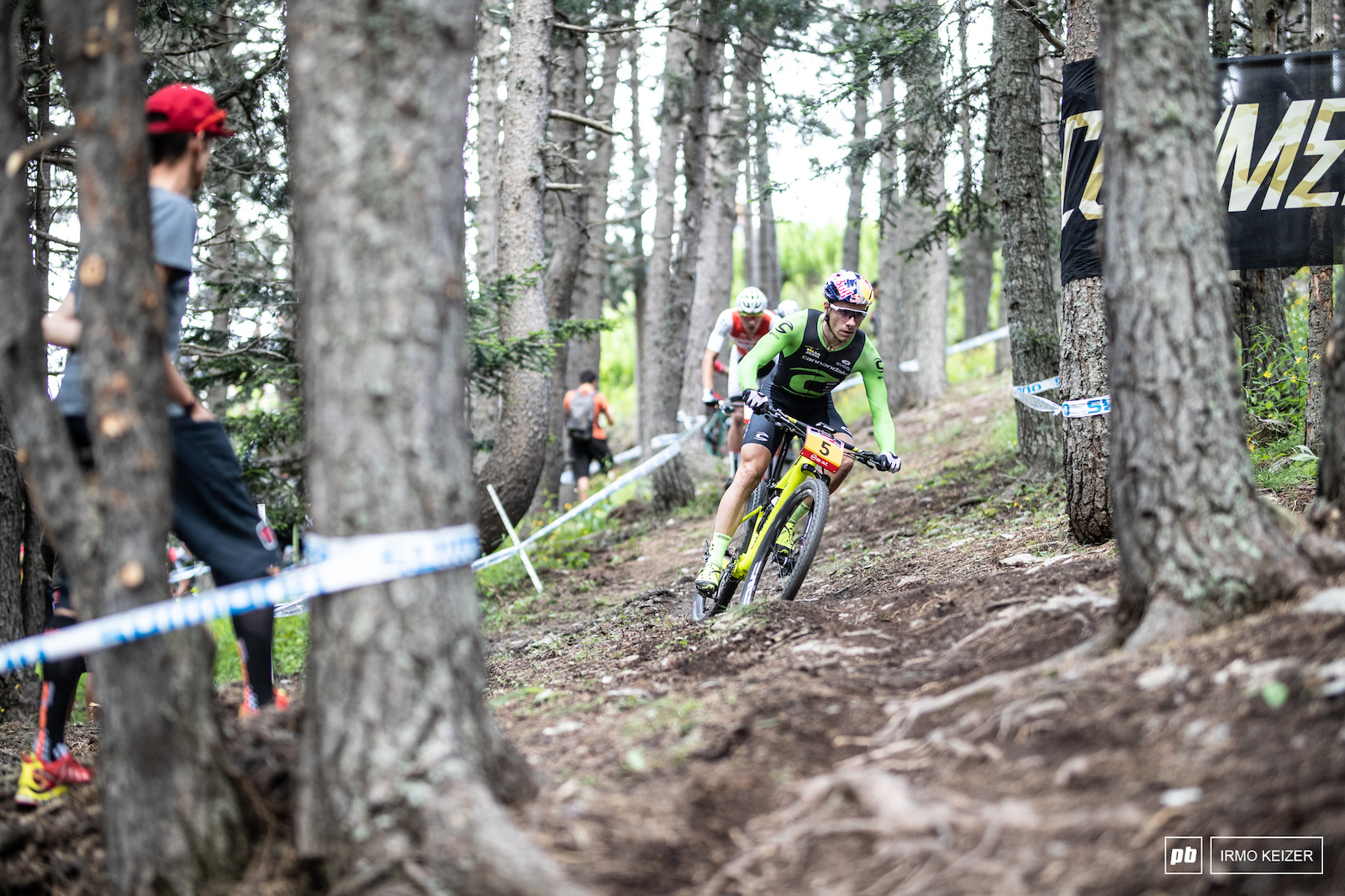 Henrique Avancini leading into the woods.
