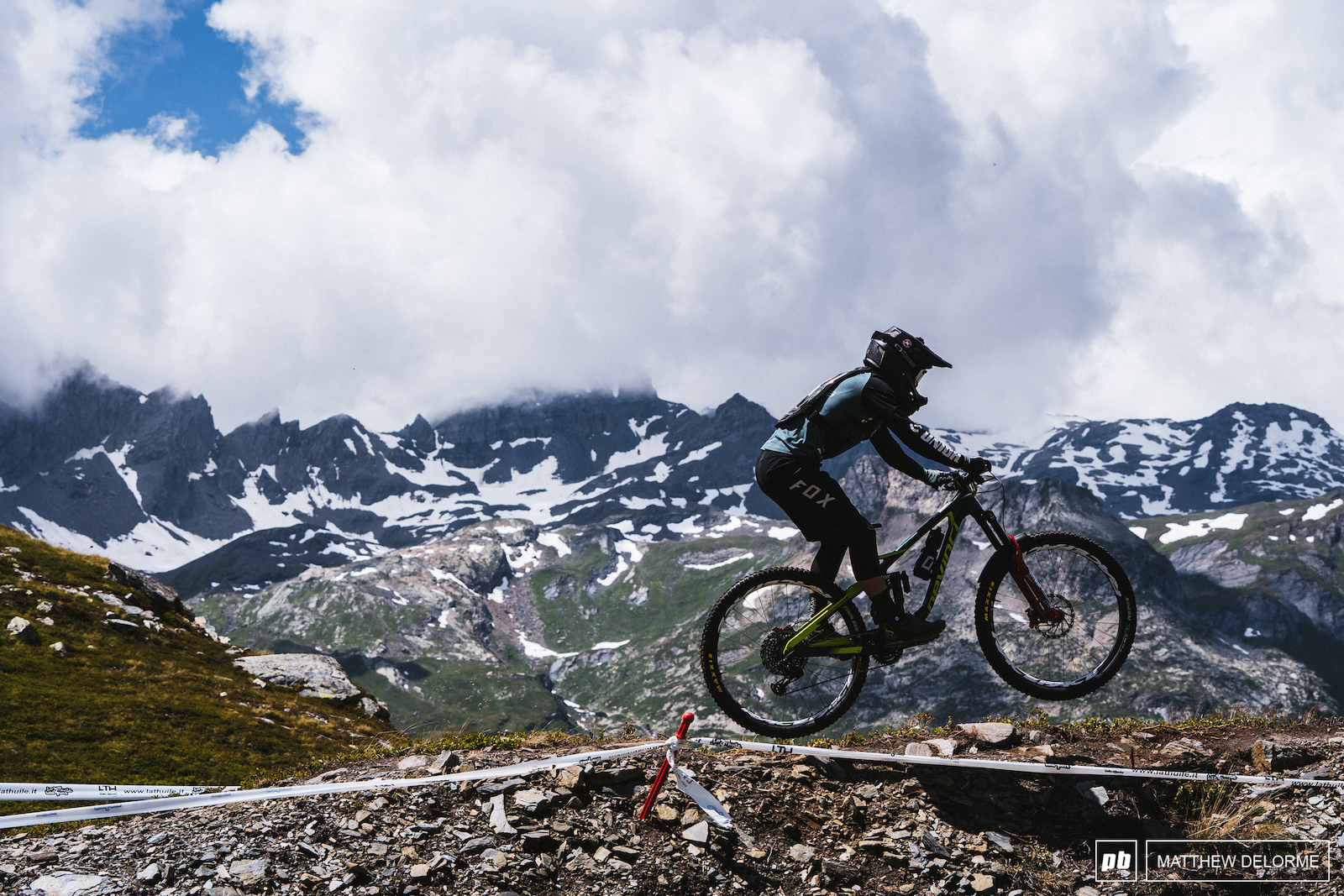 Damien Oton on his way to fifth place with jagged peaks looming in the distance.