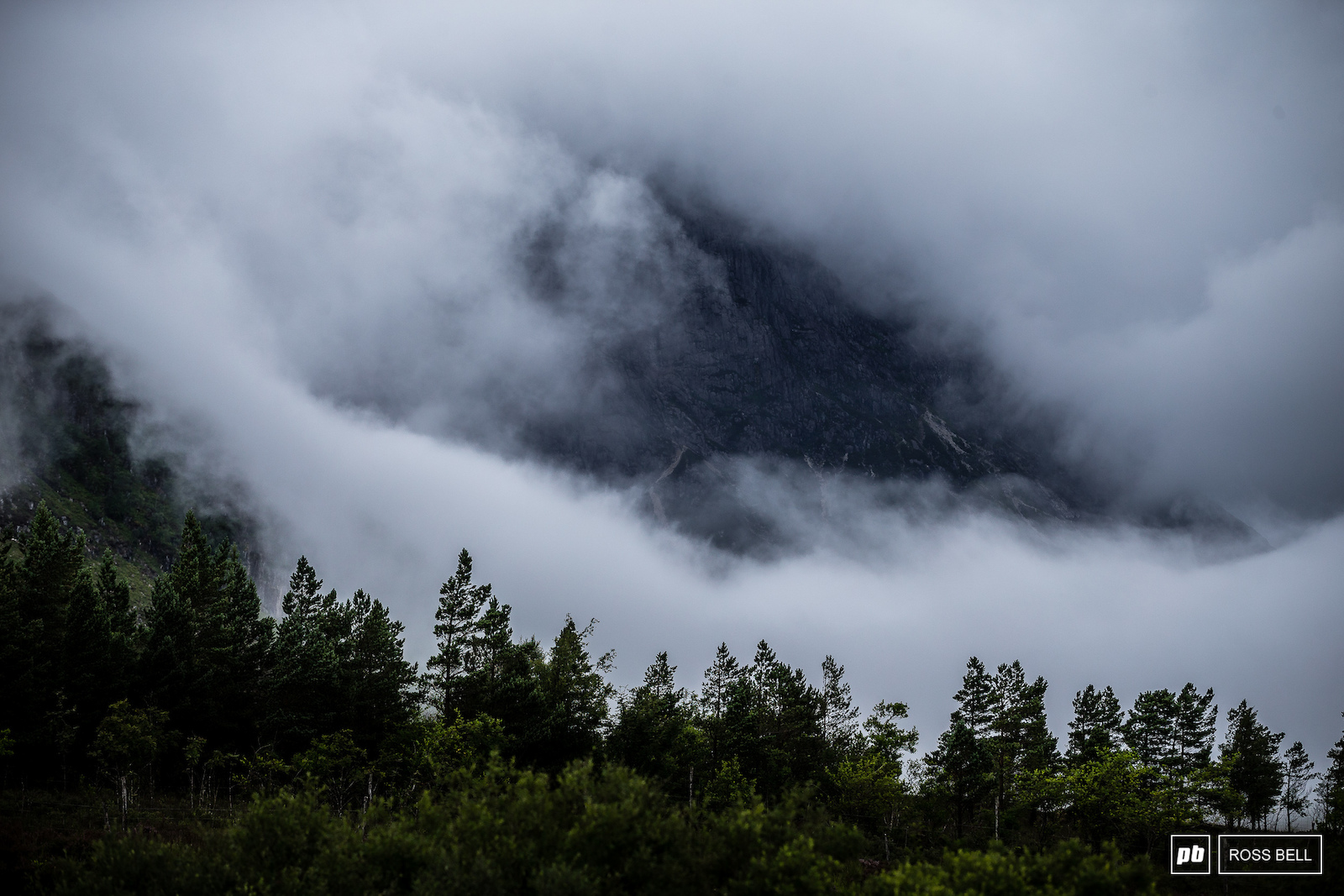 The famous Buachaille Etive M r peaking out from the cloud.