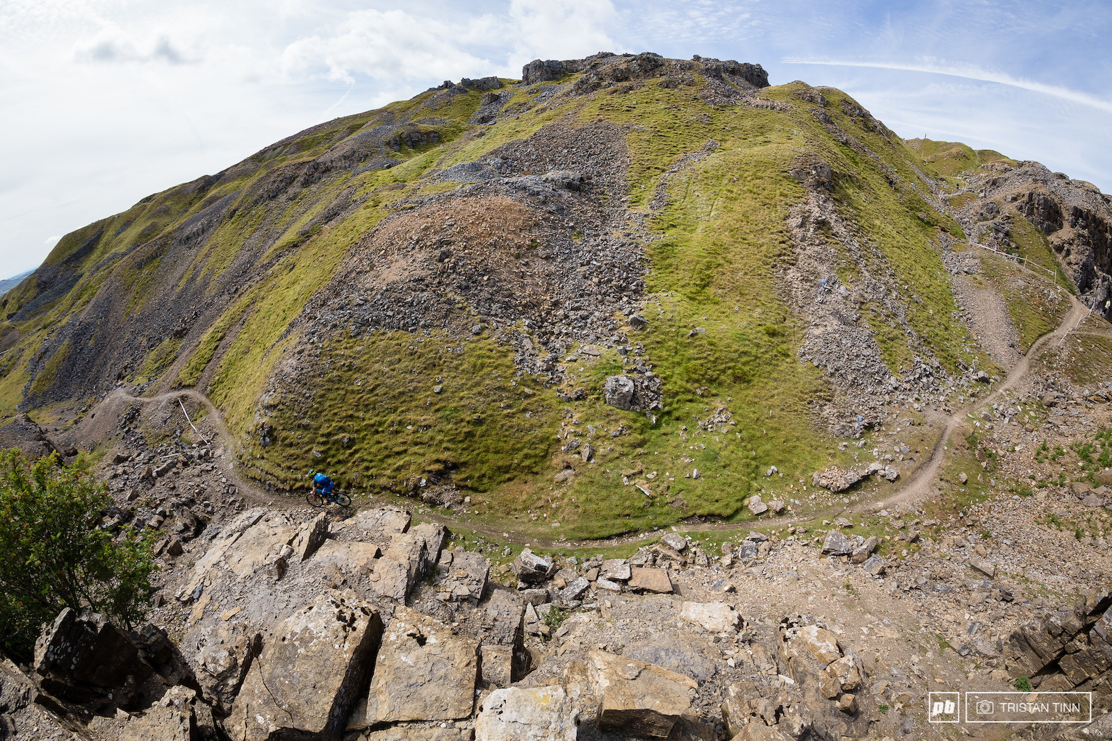 The jagged hillsides provide a dramatic backdrop for a race