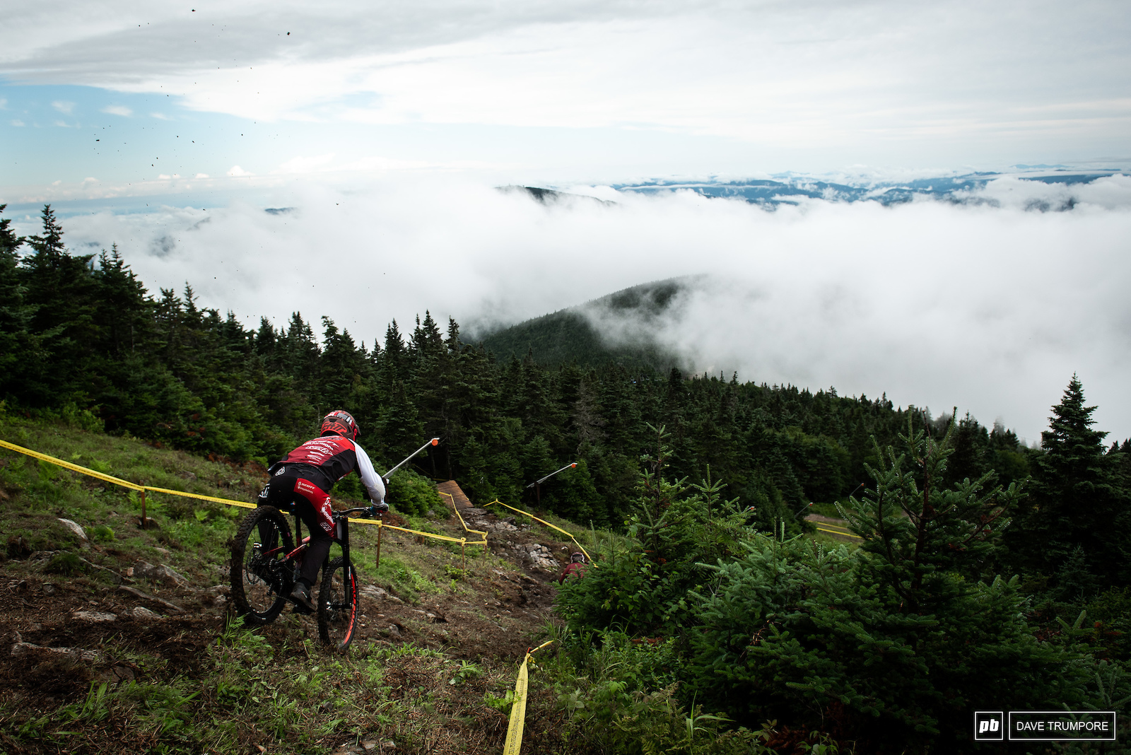 Gaetan Vige drops out of the start gate as the fog finally began to lift of the top of the mountain.