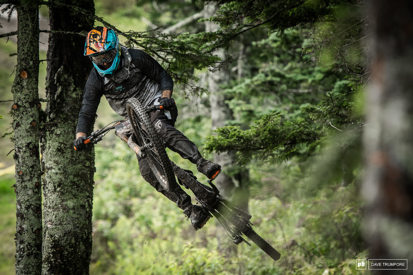 Dylan Conte sends it up into the tree branches during the very wet morning practice.