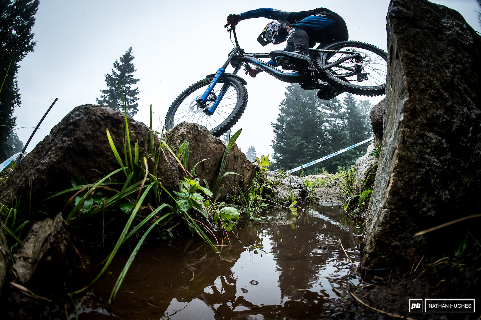 Marcello Gutierrez hops from one section of waterlogged trail to the next.