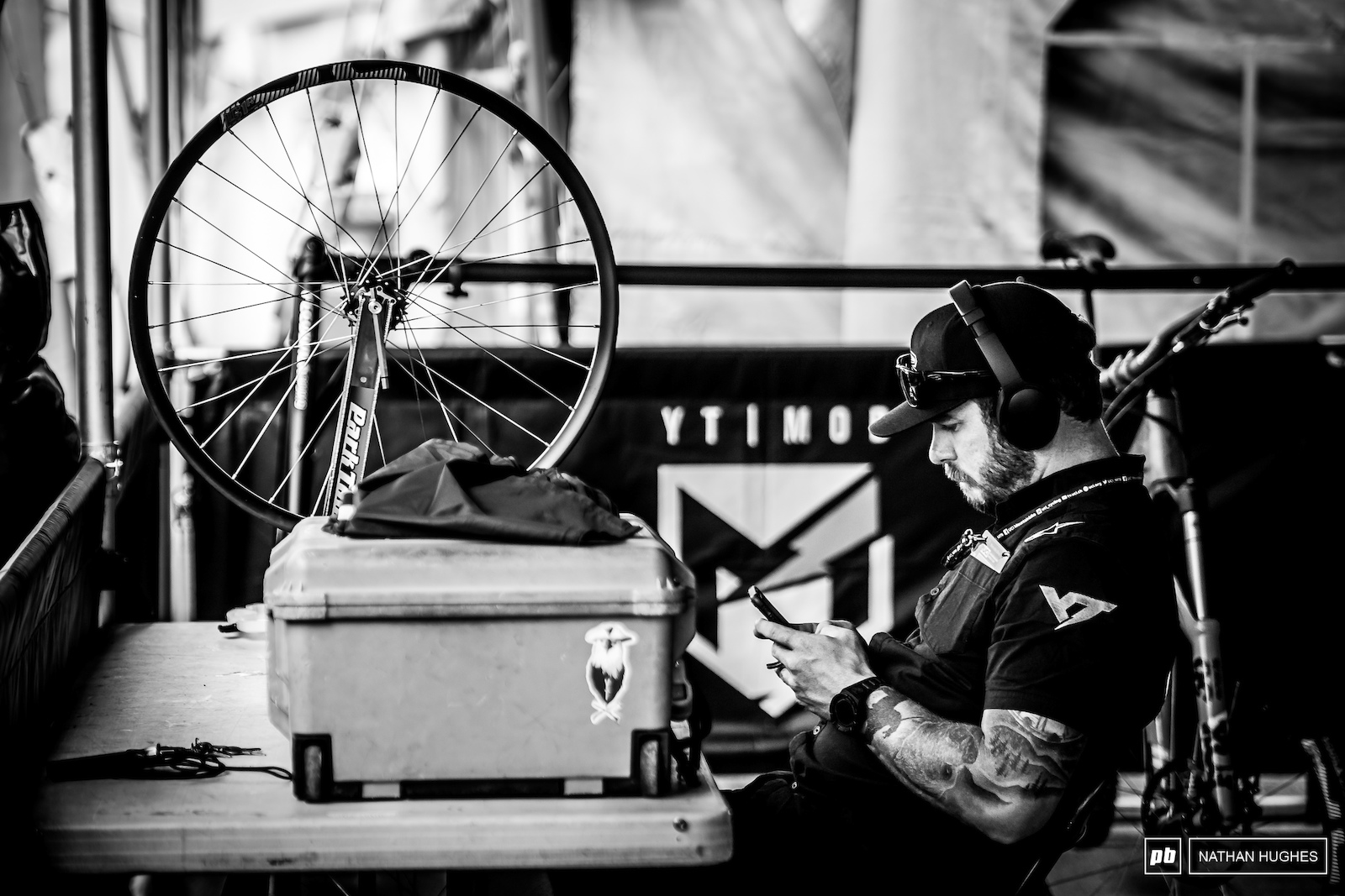 Black and white is the only option for a sad scene like this... Aaron Gwin s mechanic John Hall with nothing but time on his hands. Hopefully we ll be seeing AG back for France.