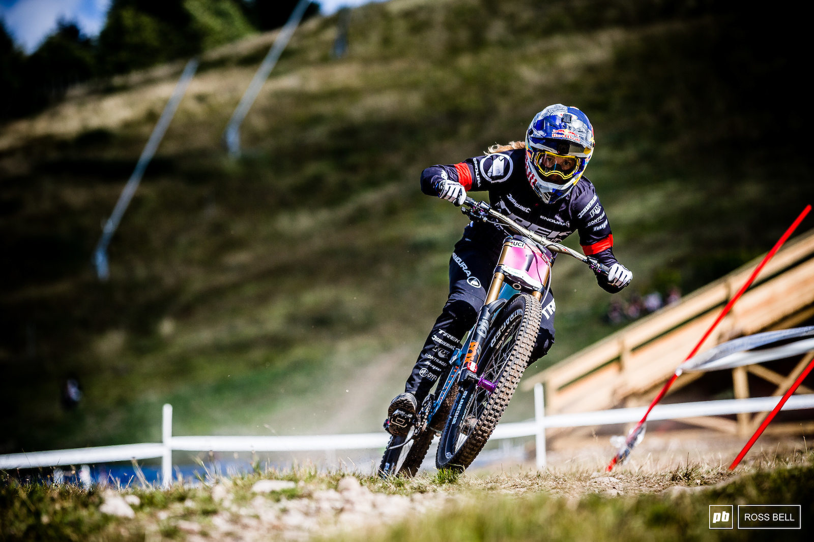Rachel Atherton pushing on through the final fast grass corners during her timed training run which would place her fastest.
