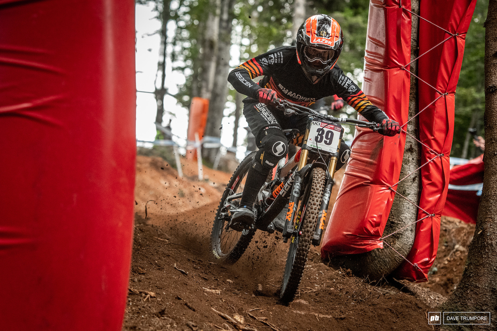 Alex Marin tries to find grip in the loose dirt and off camber roots at the top of the track.