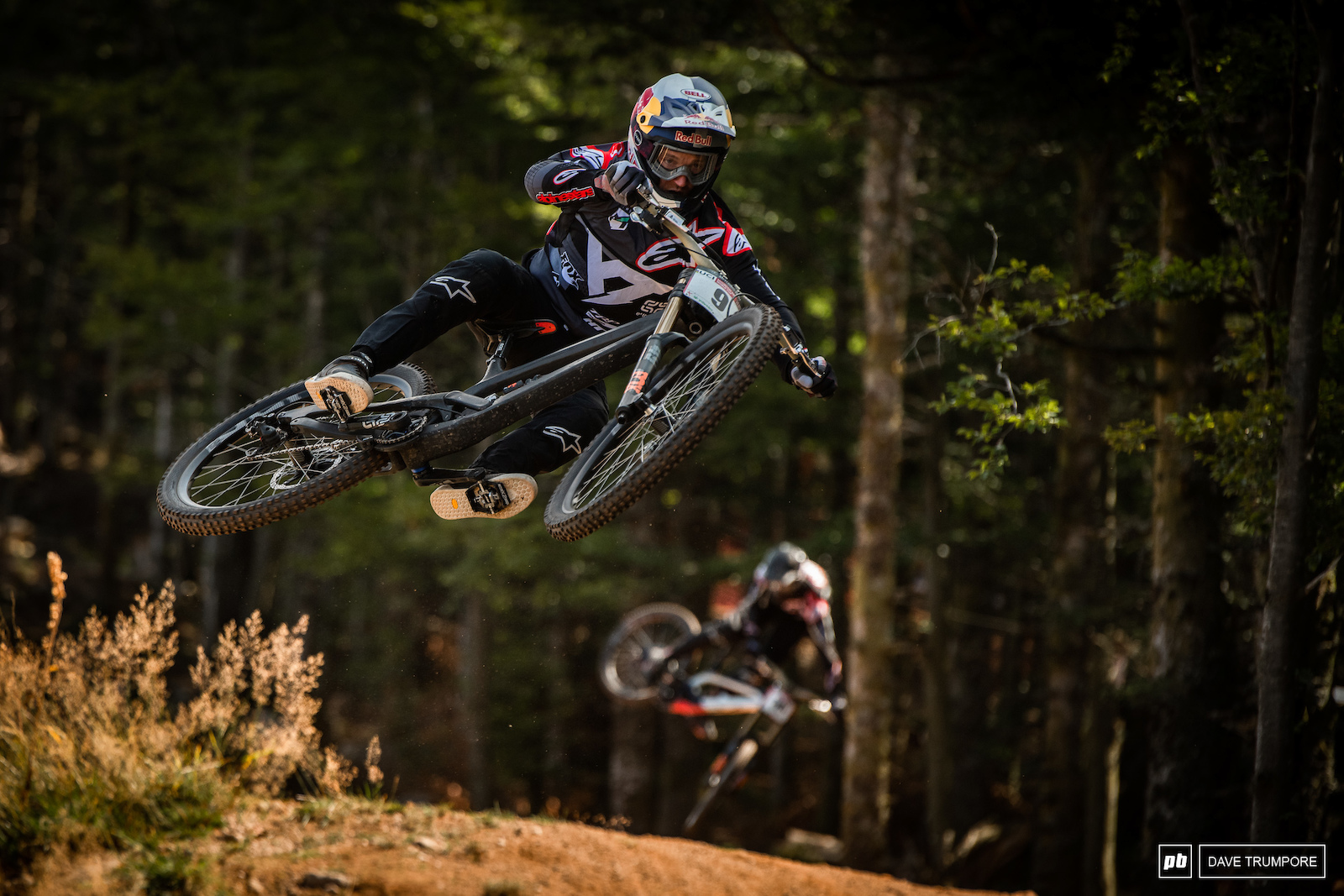 Aaron Gwin scrubs one jump and his teammate Angel Suarez whips another off in the distance.