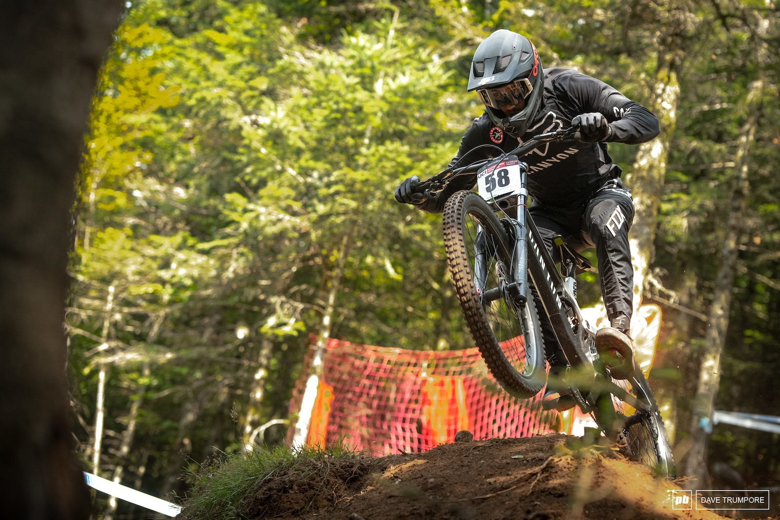 Canadain National Champ Magnus Manson pre-jumps into the steep woods mid track.