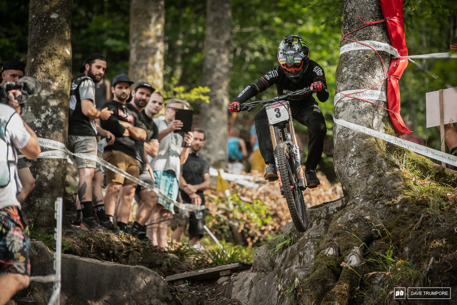 Danny Hart tucks and elbow and keeps it tight against the tree down into the final rock chute.