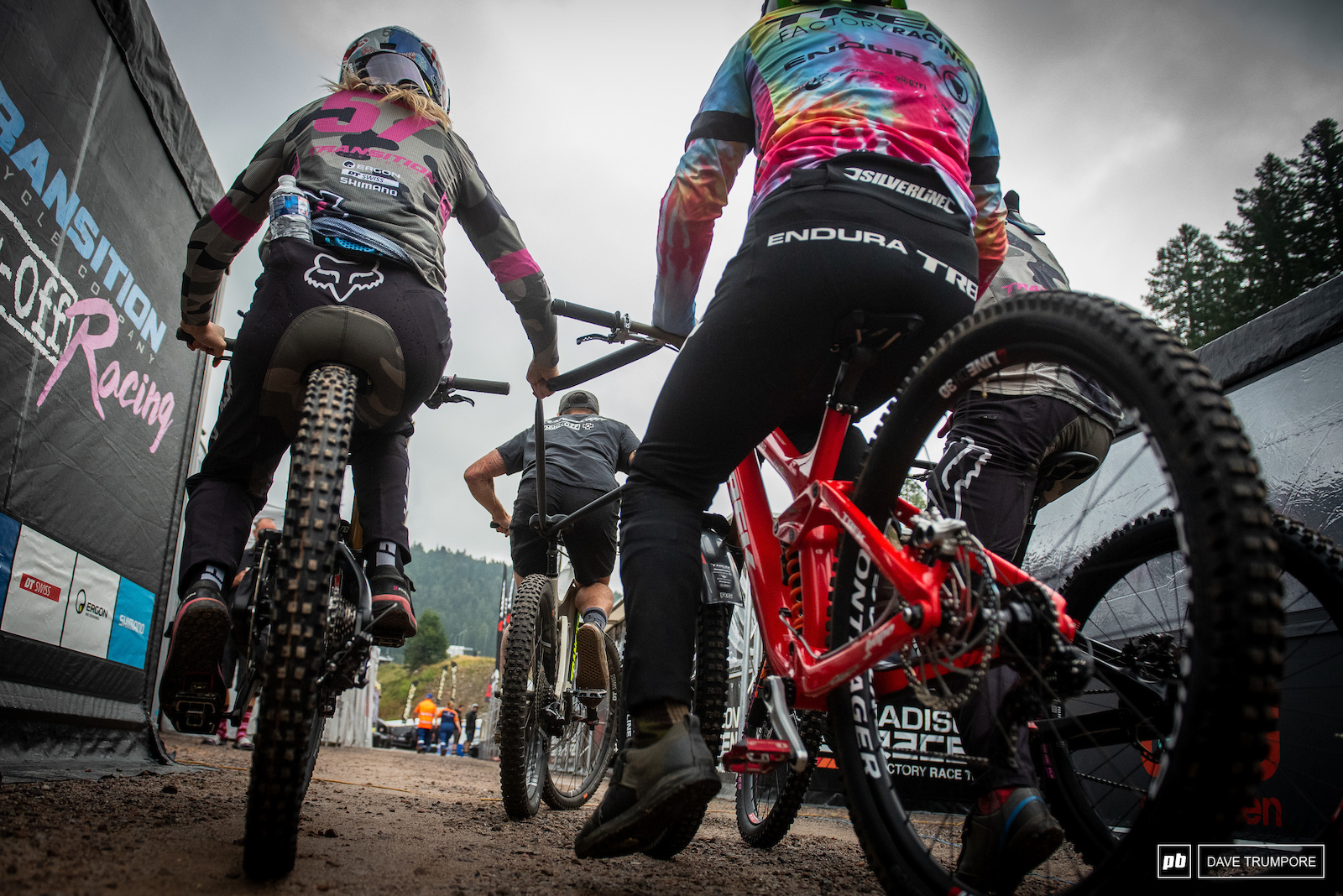 Tahnee Seagraves mechanic gives her Kade Edwards and Jamie Edmondson an E-Bike lift up the long hill from the pits to the chairlift.