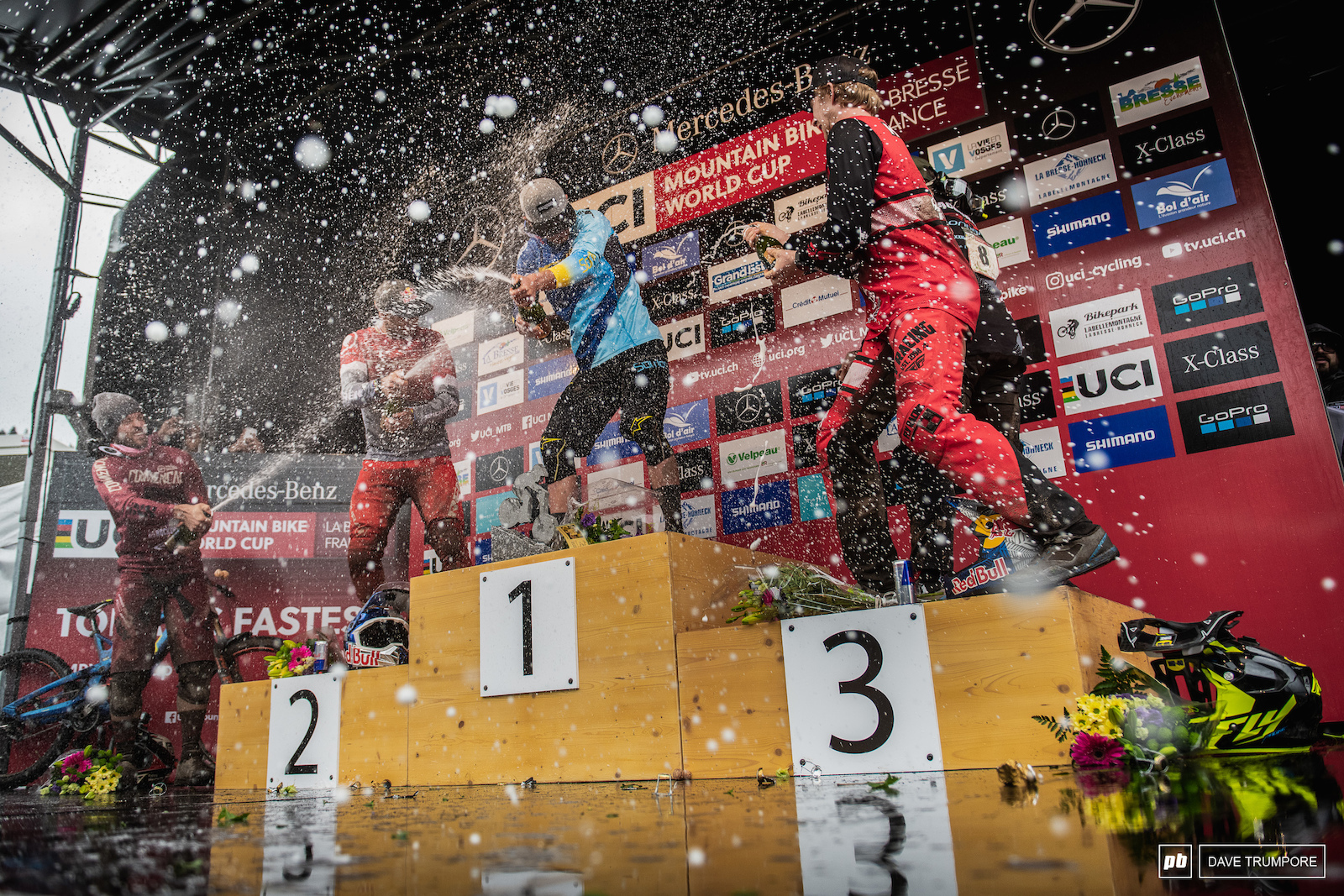 The hardest rain of the day fell on Martin Maes in the form of champagne from atop the podium.