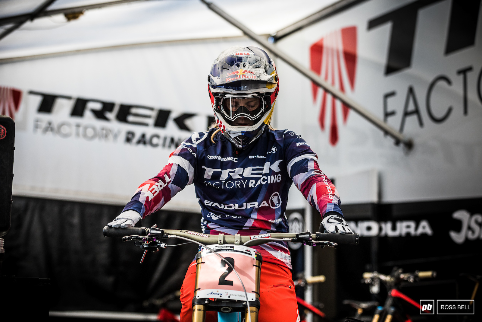 Rachel Atherton making sure her cockpit is exactly to her her liking before getting stuck into practice.