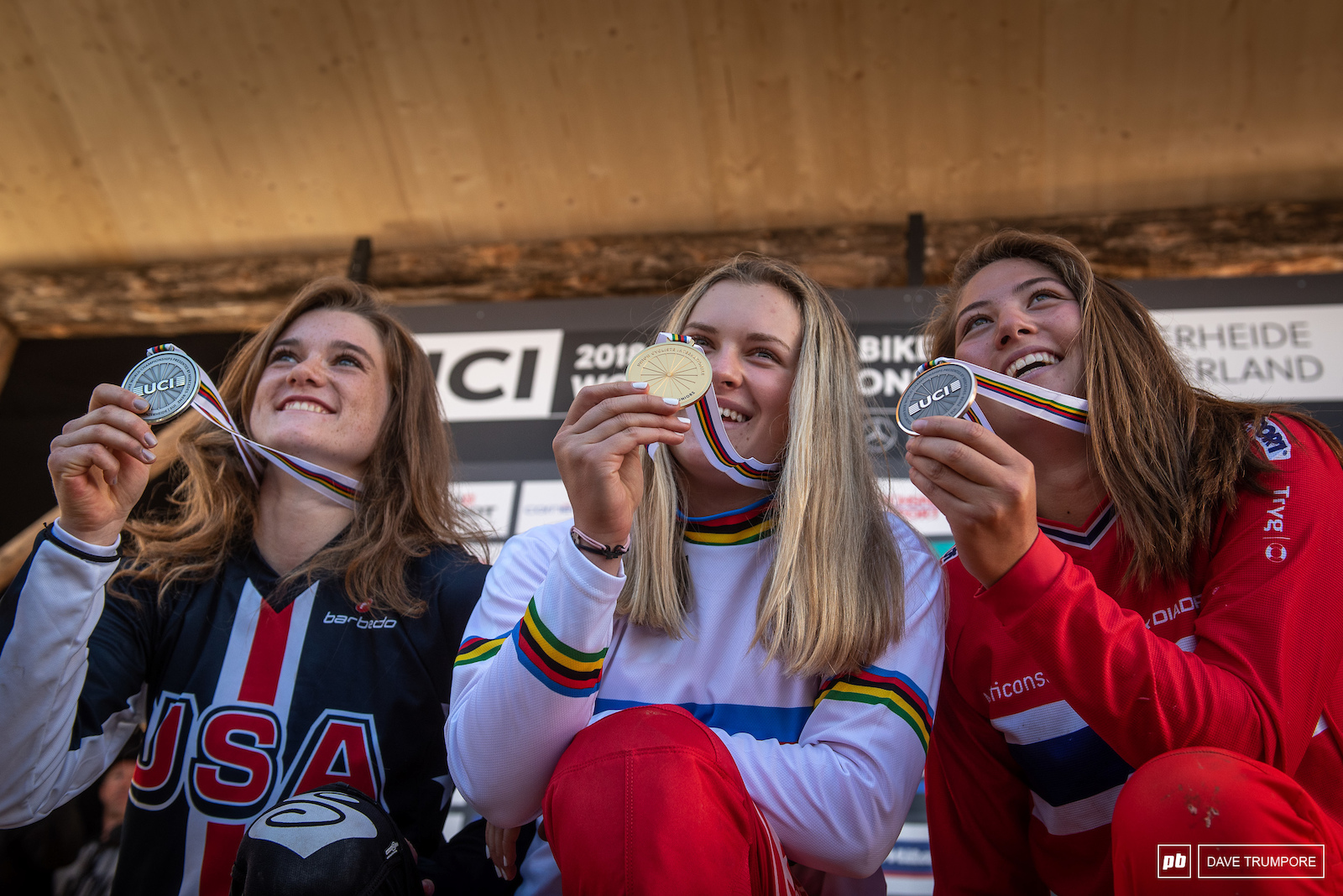 Valle Holl Anna Newkirk and Mille Johnset celebrate gold silver and bronze in Junior women.