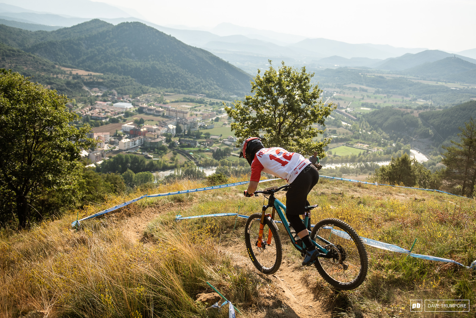 Jesse Melamed chopping corners off on the inside and gaping over ruts to find the fastest way down the tricky Stage 5.