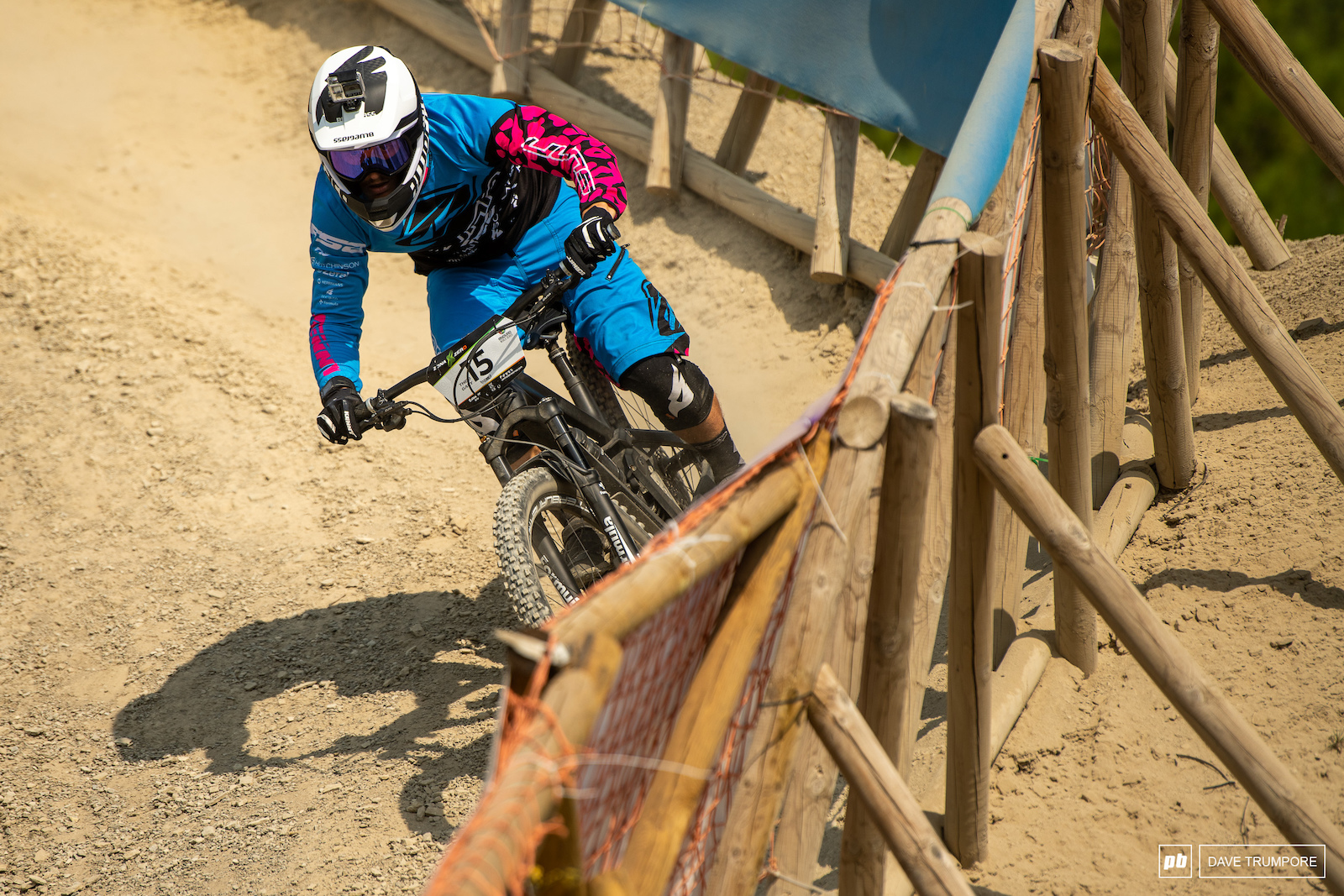 Luckily this fence stands between Theo Galy and a 50 meter cliff should anything go wrong around this high speed corner.