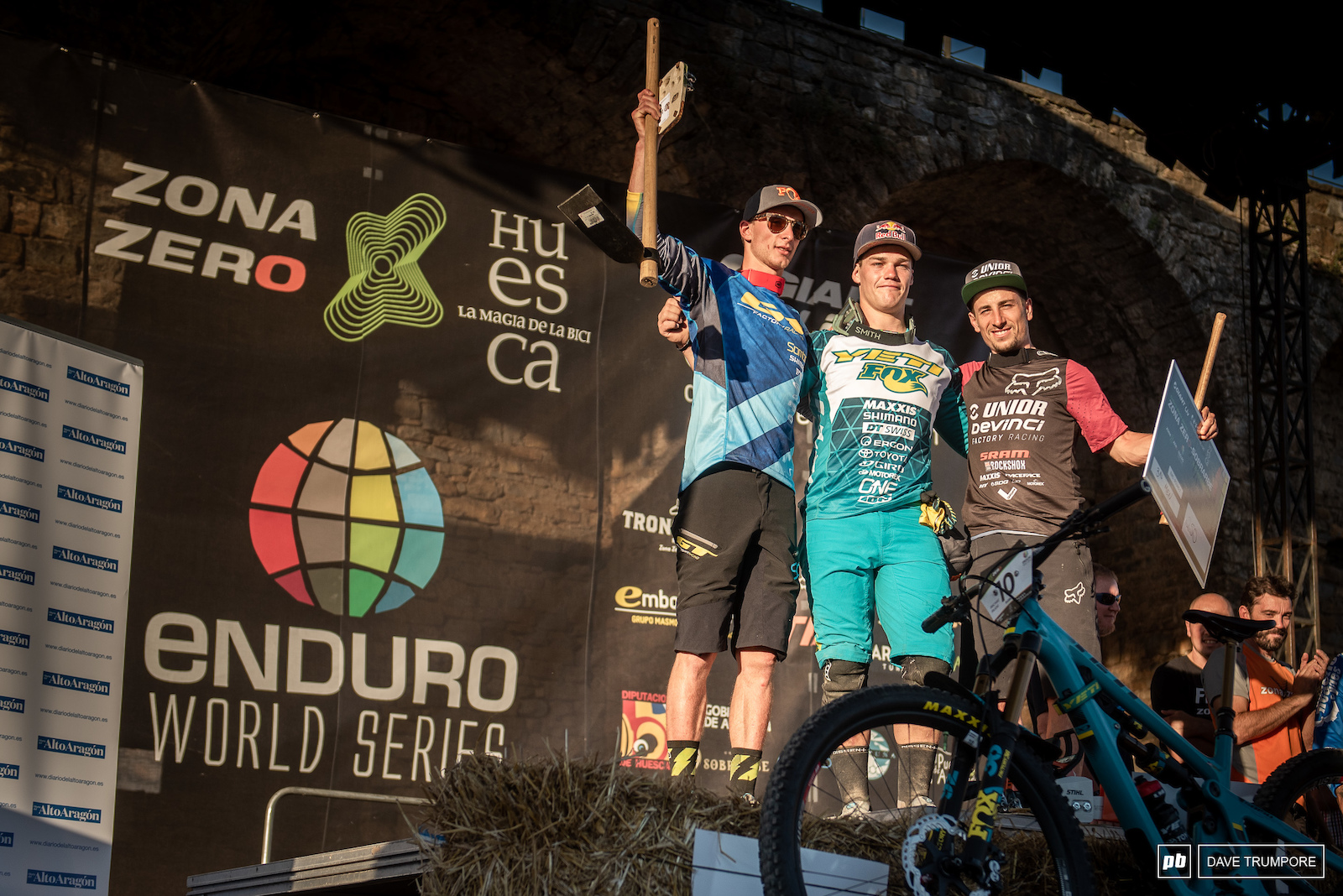 Richie Rude shares the top steps of the podium with Martin Maes and Damien Oton.