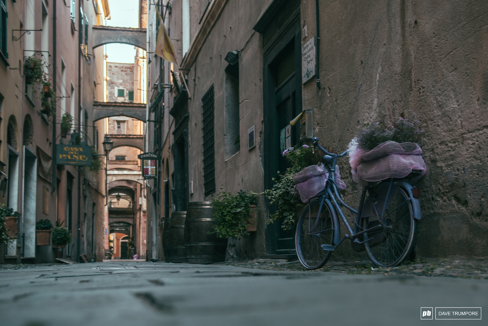 Arches alleys and bicycles along side street in Finale Ligure.