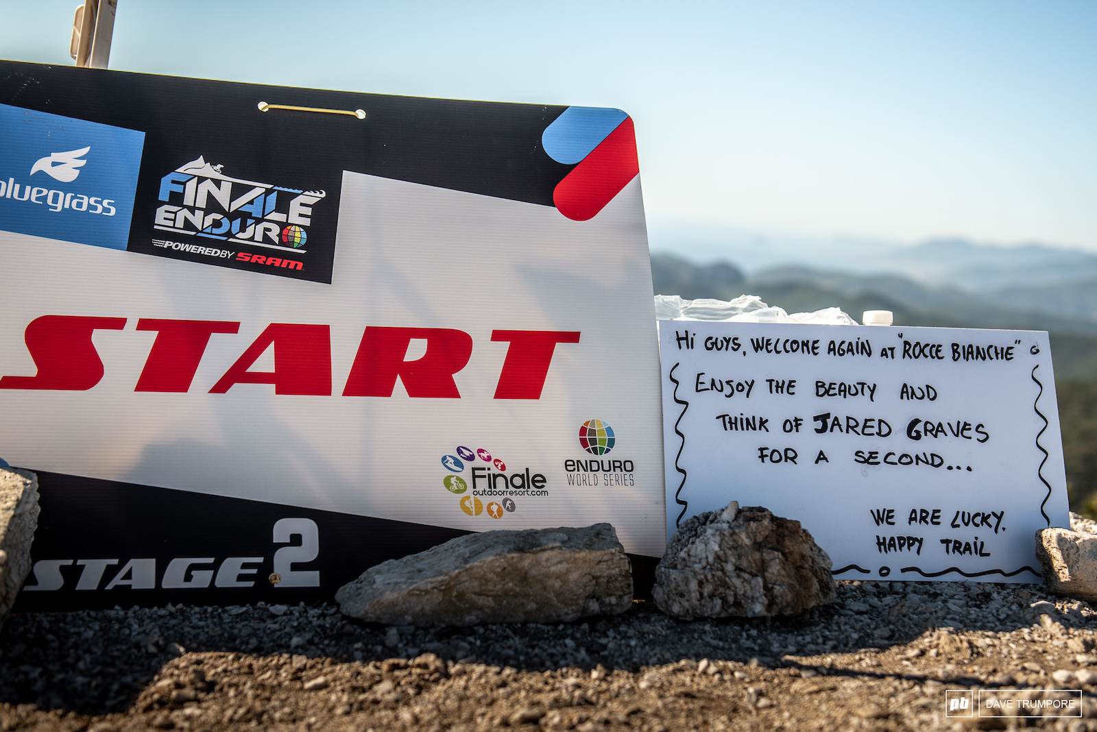 A great reminder about the important things as riders reach the top of the long climb to Stage 2.