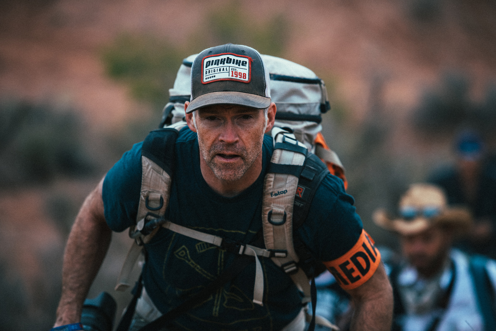 Colin Meagher hiking up the course for the 2015 Redbull Rampage.