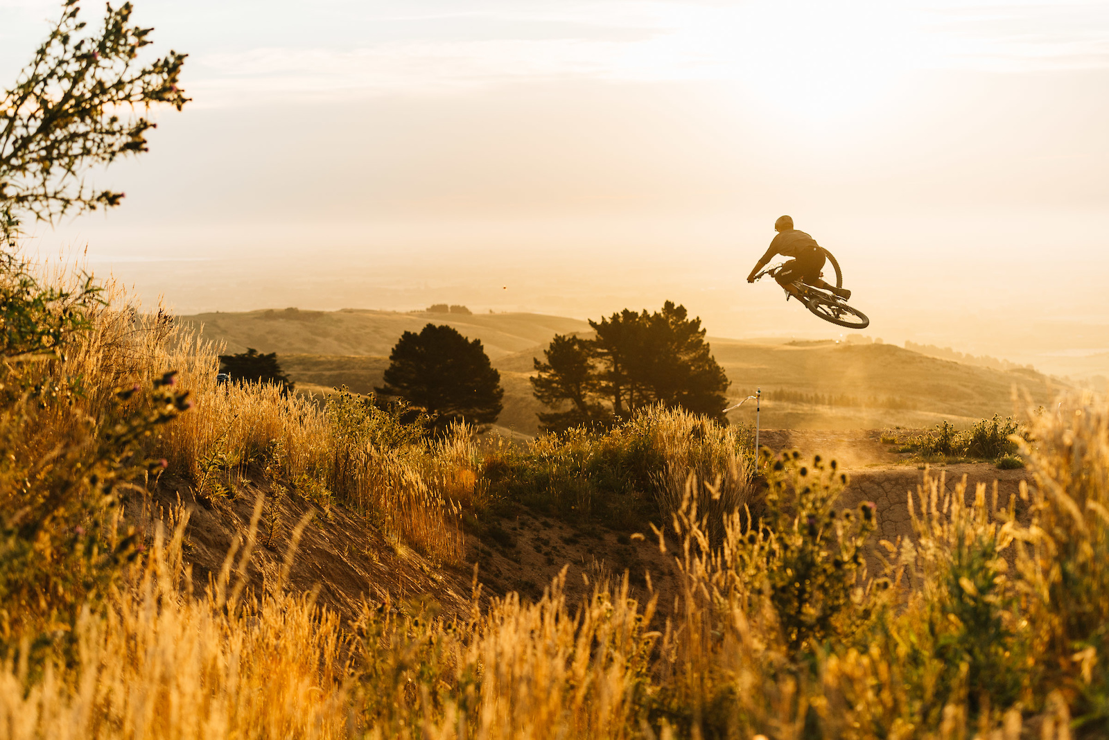 Sam shows his style and comfort on a bike over the tables on Airtearoa.