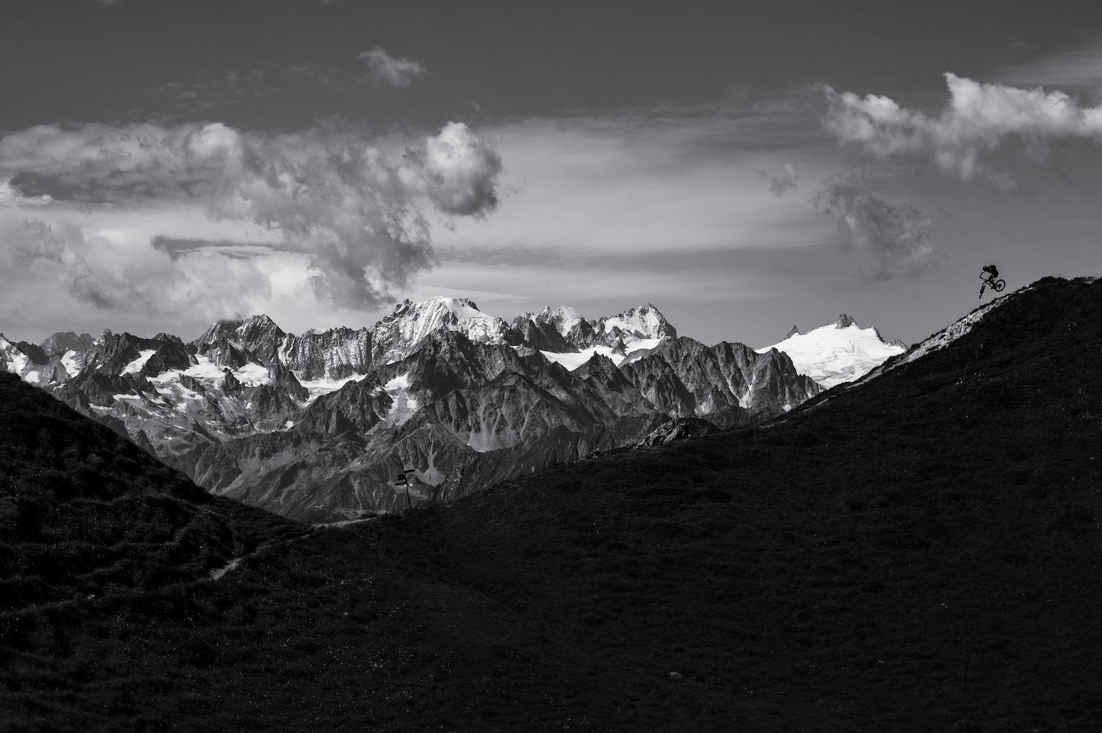 Stephen Matthews dropping in high above Verbier, Switzerland.