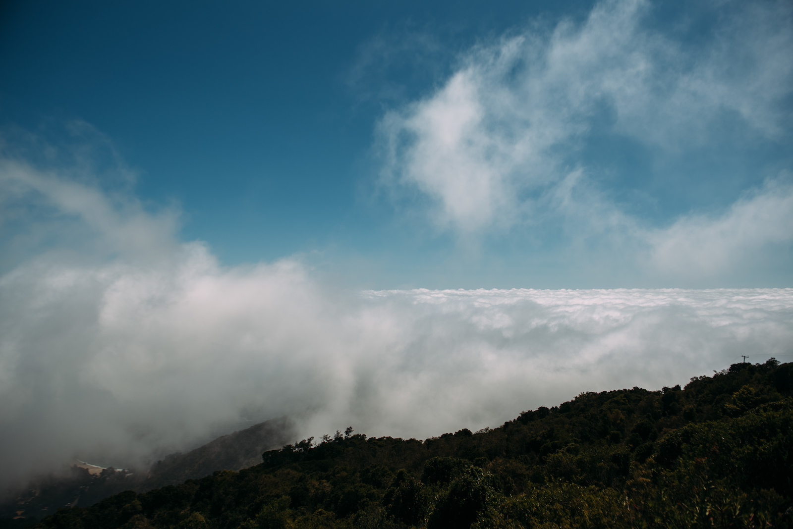 The top of the final stage. Above the clouds with the Pacific Ocean just below.