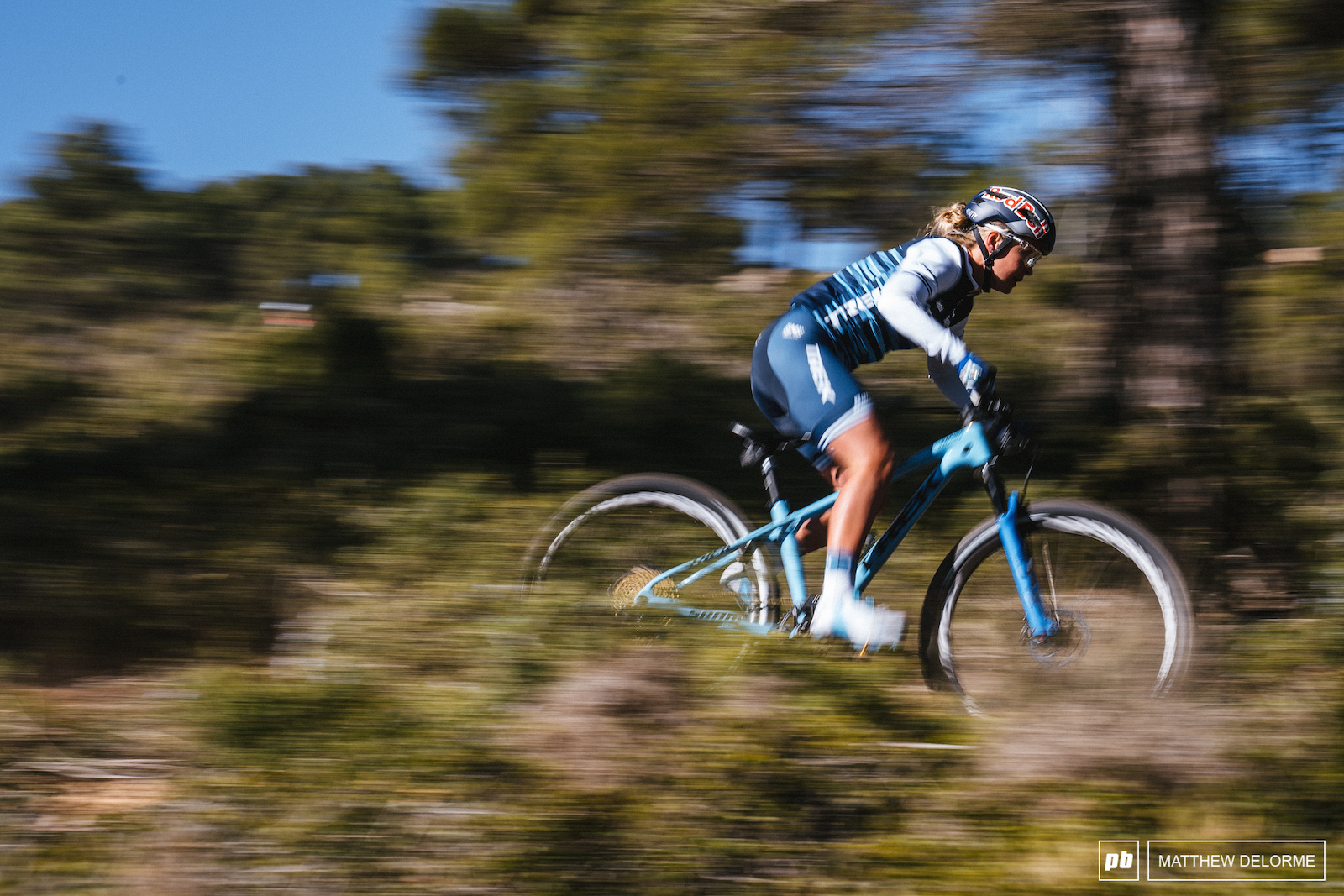 Emily Batty speeds through the Spanish pines.