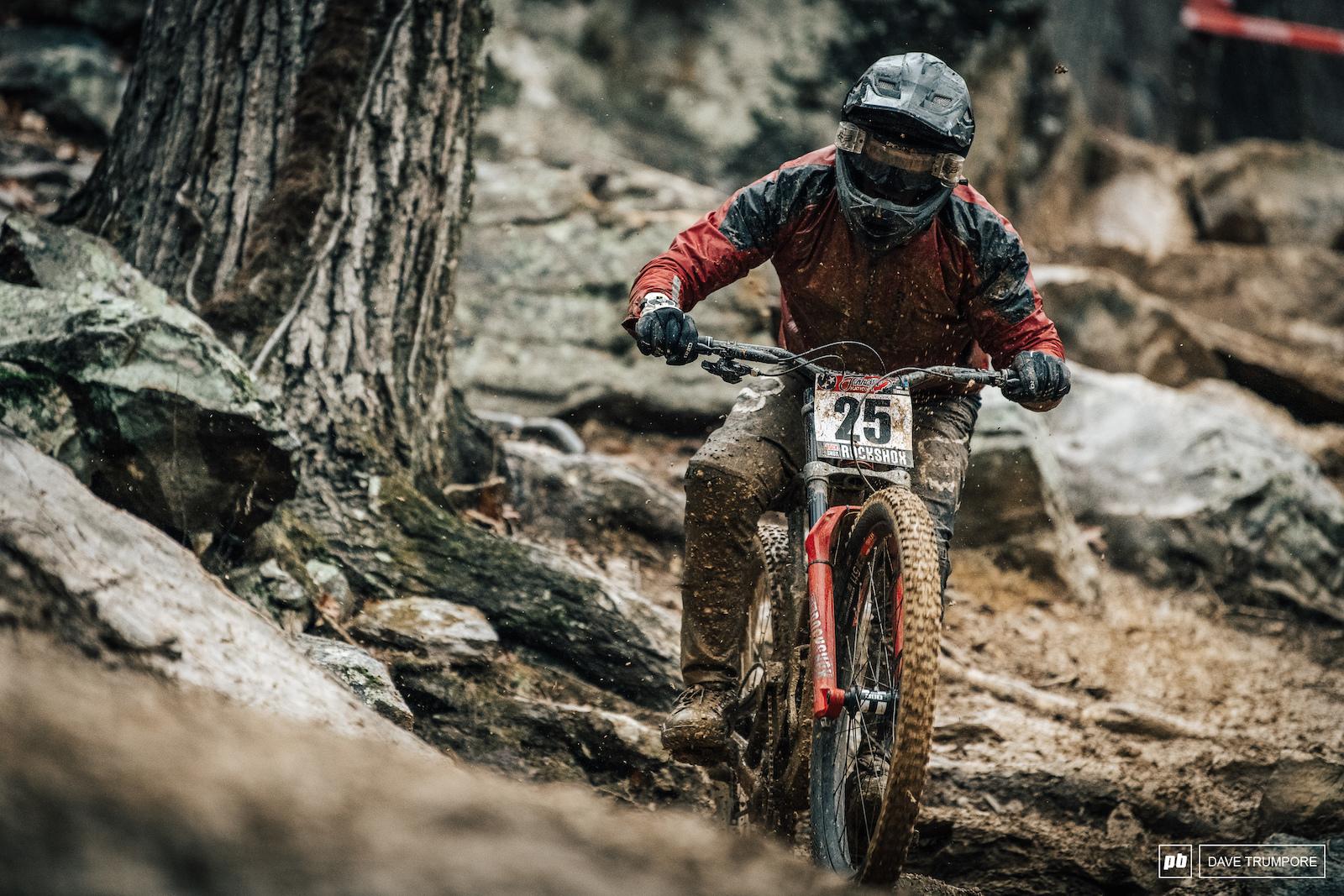 Benjamin Despres Morin battle through the extra muddy rock garden in practice