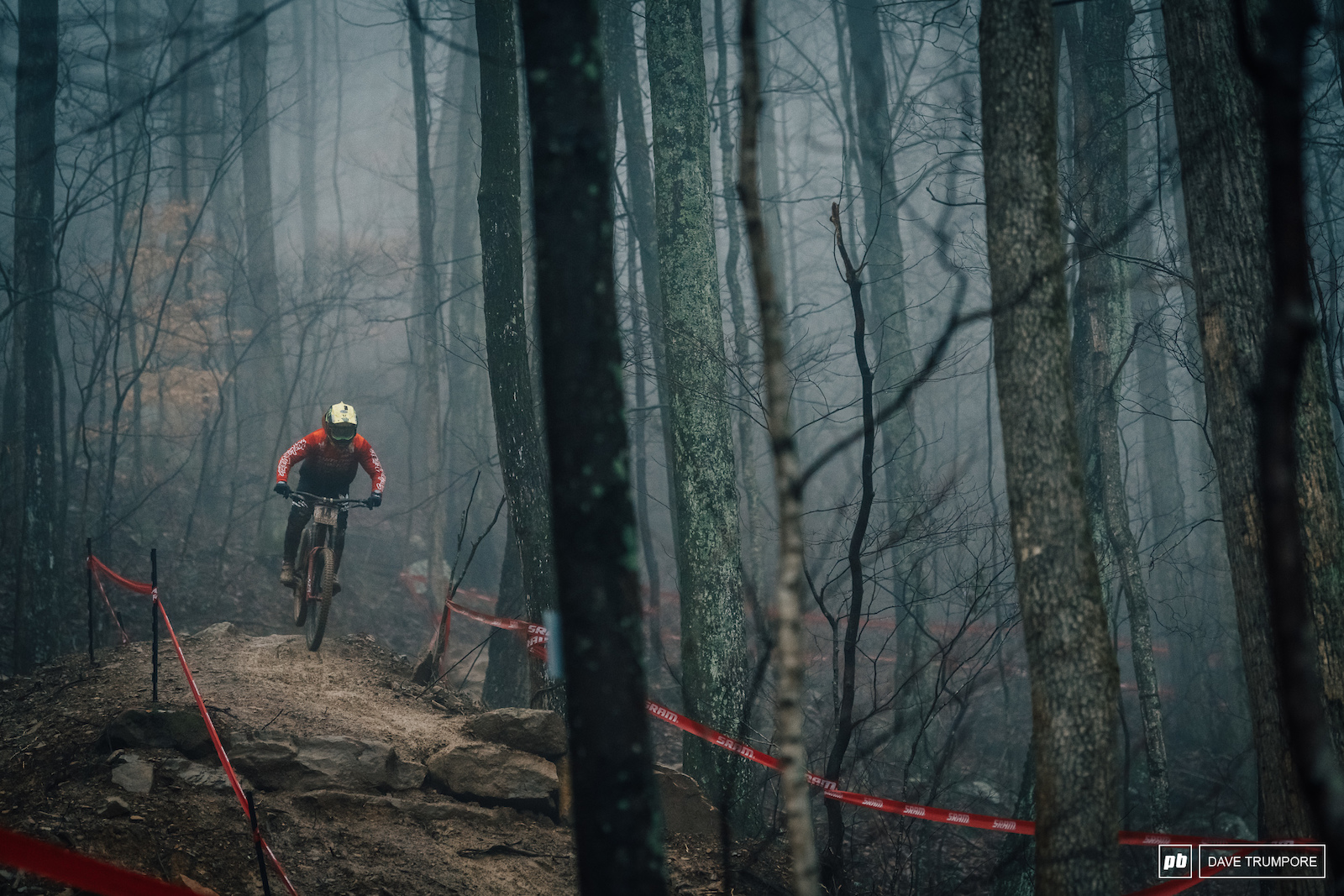 Mitch Ropelato drops through the foggy woods.