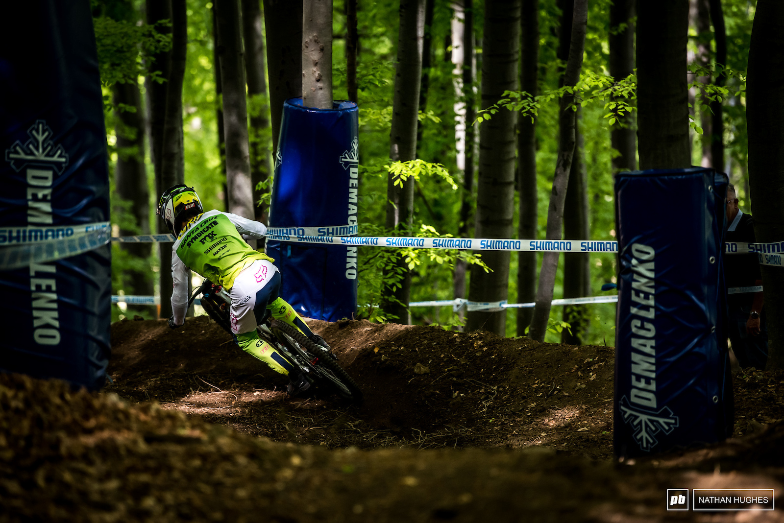 Loris Vergier cutting into the forest loam in his new green race kit.