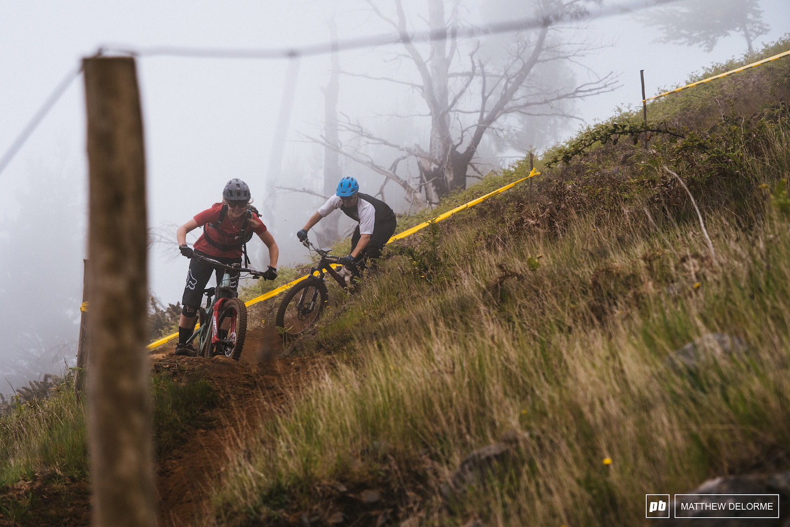 Bebe and James Parkin descend a foggy Gamble trail.