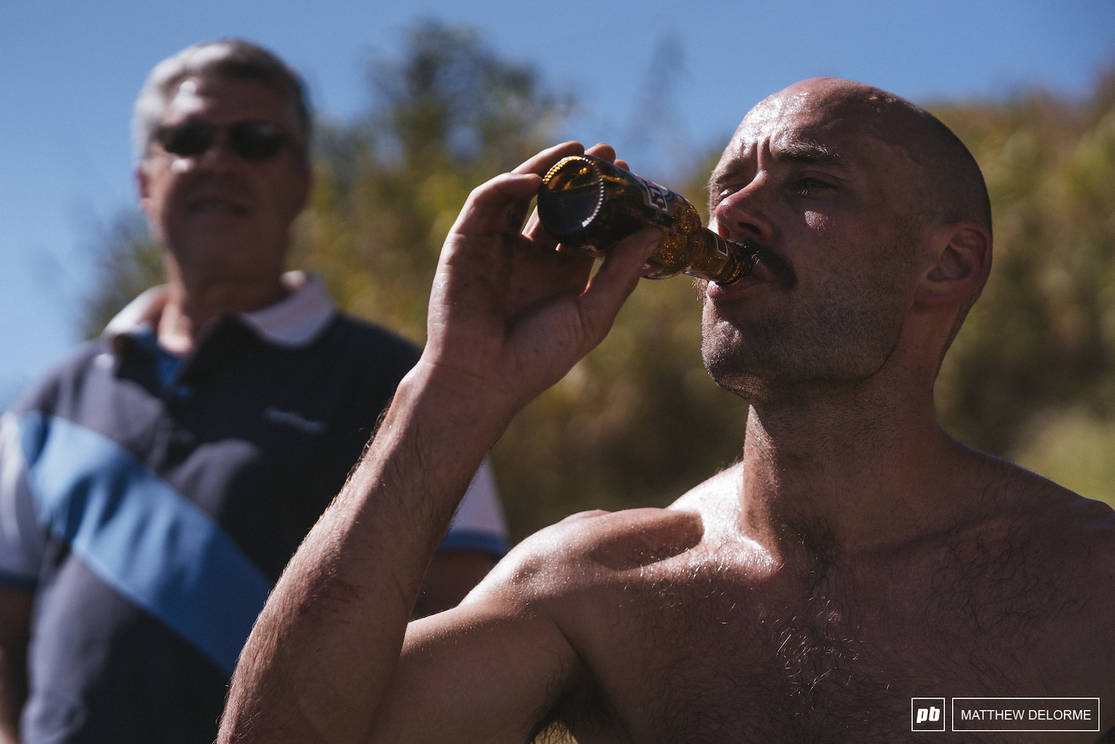 Eddie Masters enjoys a small beer after a long weekend of racing.