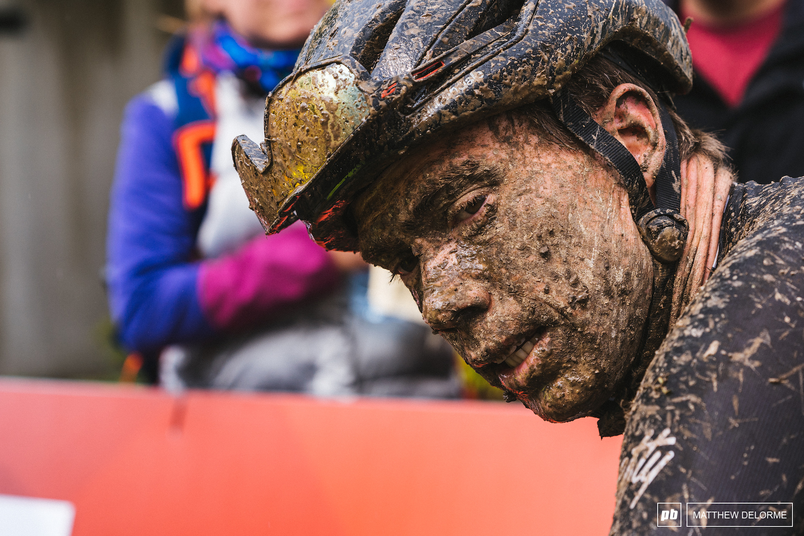 Maxime Marotte wearing all of the mud after the race.