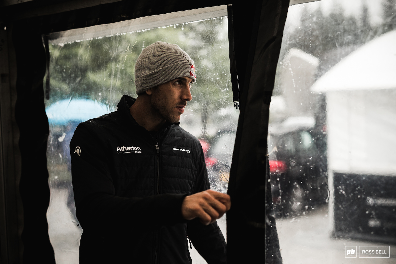 Gee Atherton checking for a break in the weather.