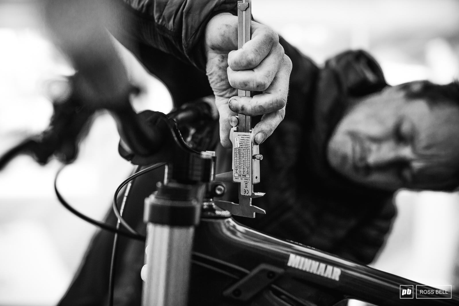 Greg Minnaar s mechanic Jason Marsh making sure the South African s setup is millimetre perfect.