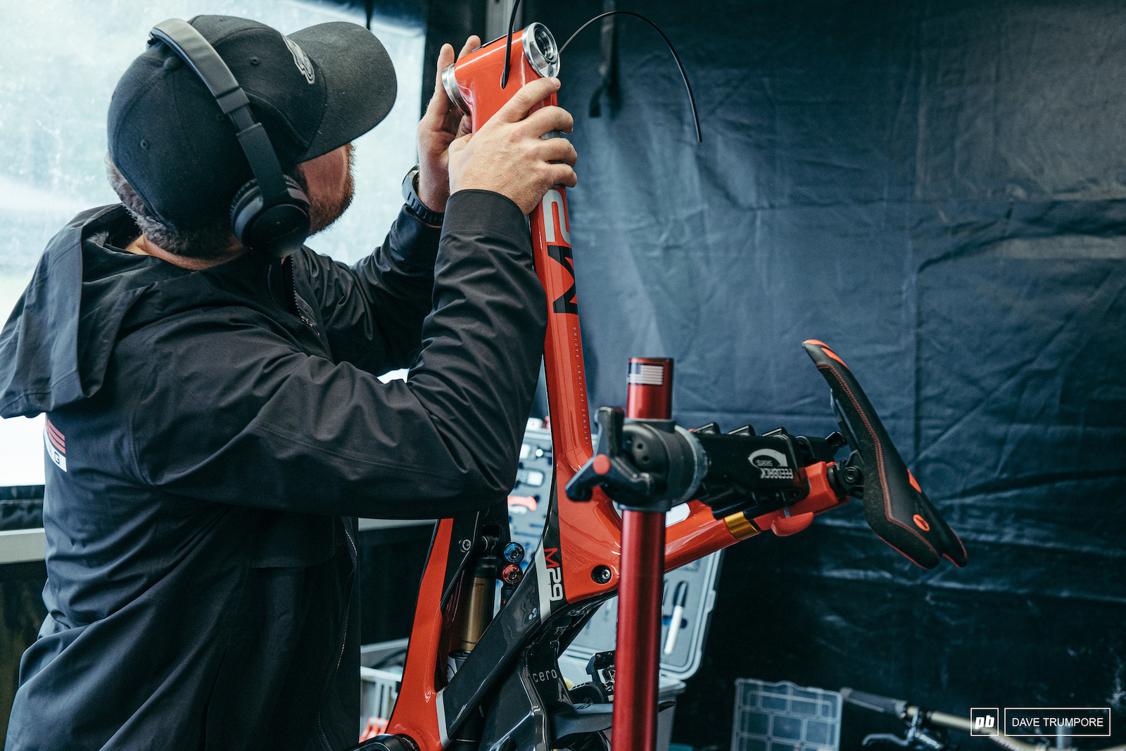 Aaron Gwin s mechanic making some reach adjustments to the headset of his race bike before tomorrow s practice session