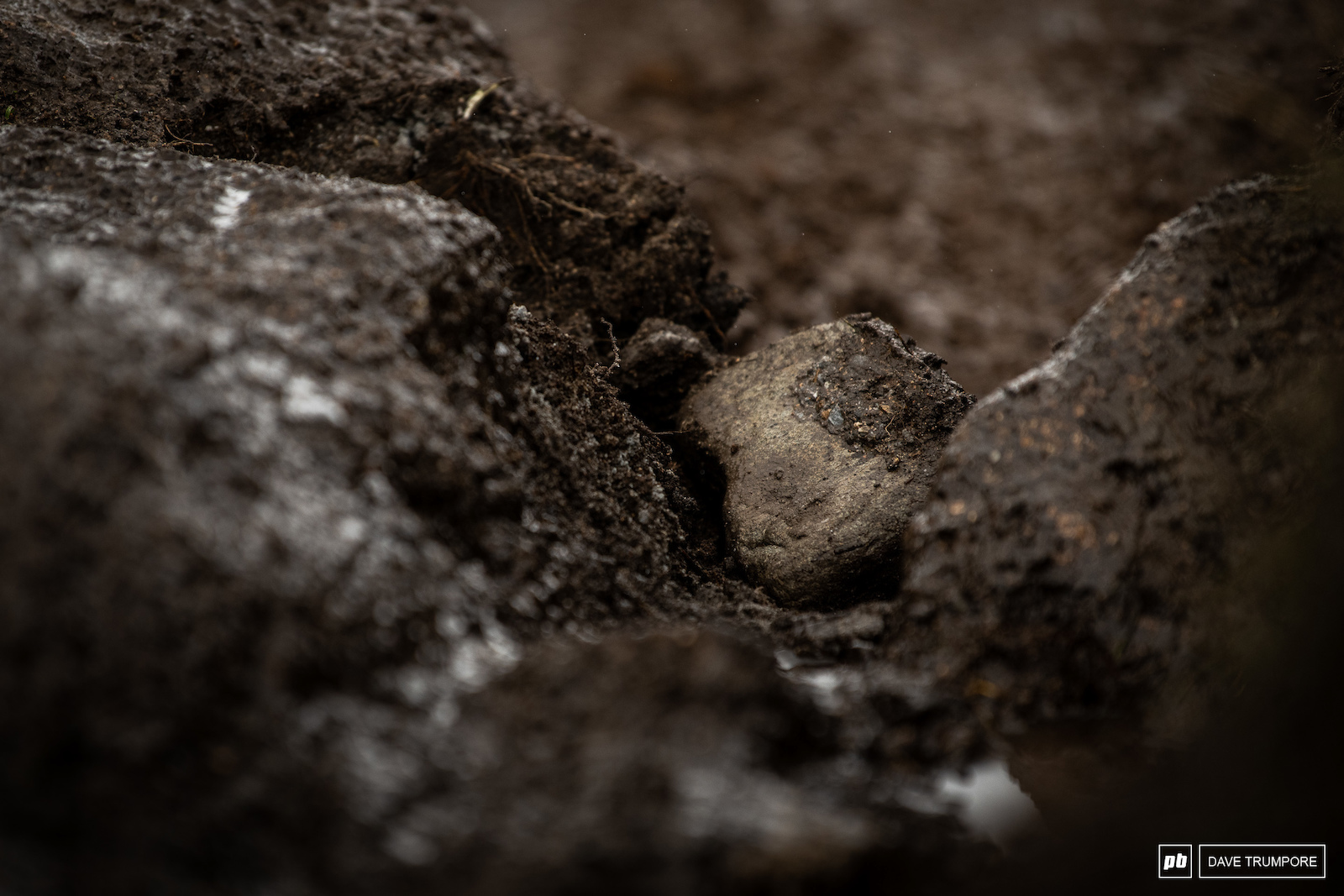 The rocks are coming loose in some of the more saturated sections of track. More than a few riders hit the deck after finding one of these grenades hiding in a normally clean racing line.
