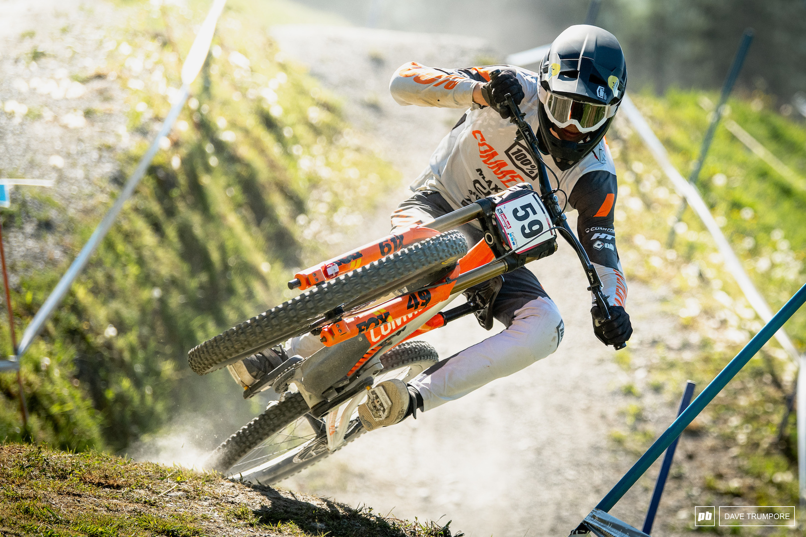 Hugo Frixtalon s front wheel kicks up the dust as he scrubs one of the fastest jumps on the lower motor way section.