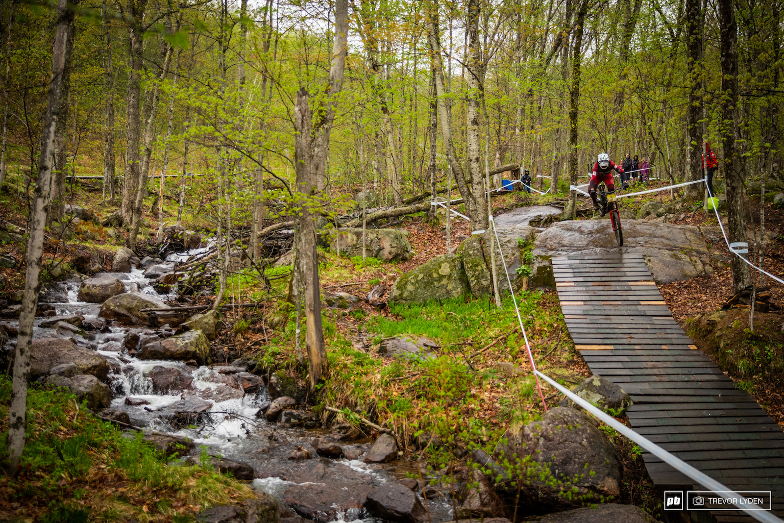 A flowing creek alongside the downhill track.