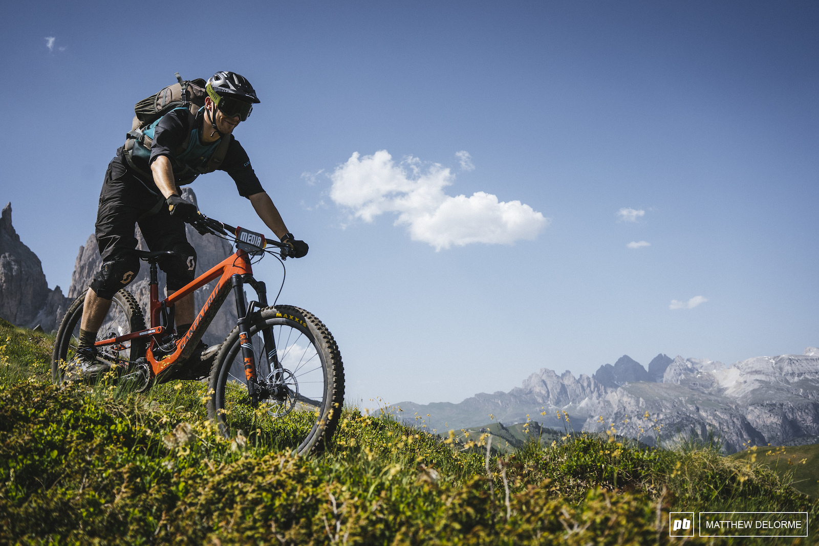 Chris Seager dives into stage five with the jagged teeth of the Dolomites looming in the back ground.