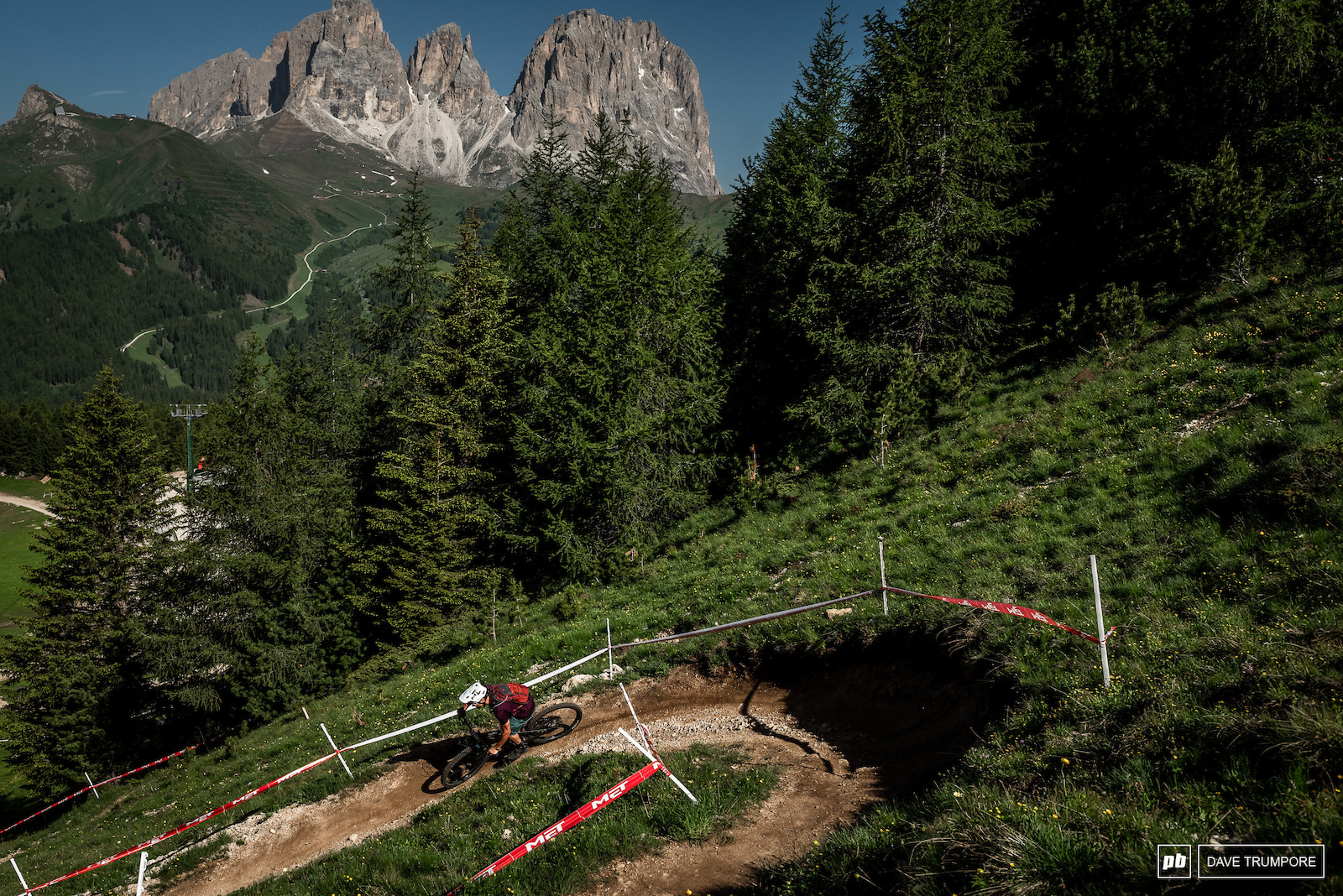 The top of Stage 1 offers some brief views of the Dolomites before diving in to the forest.