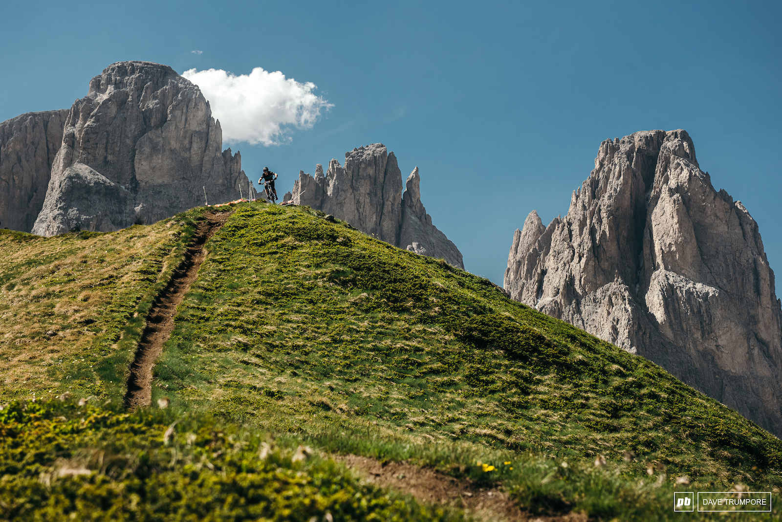 Eduro World Series director Chris Ball drops into Stage 5 below the iconic Dolomites.