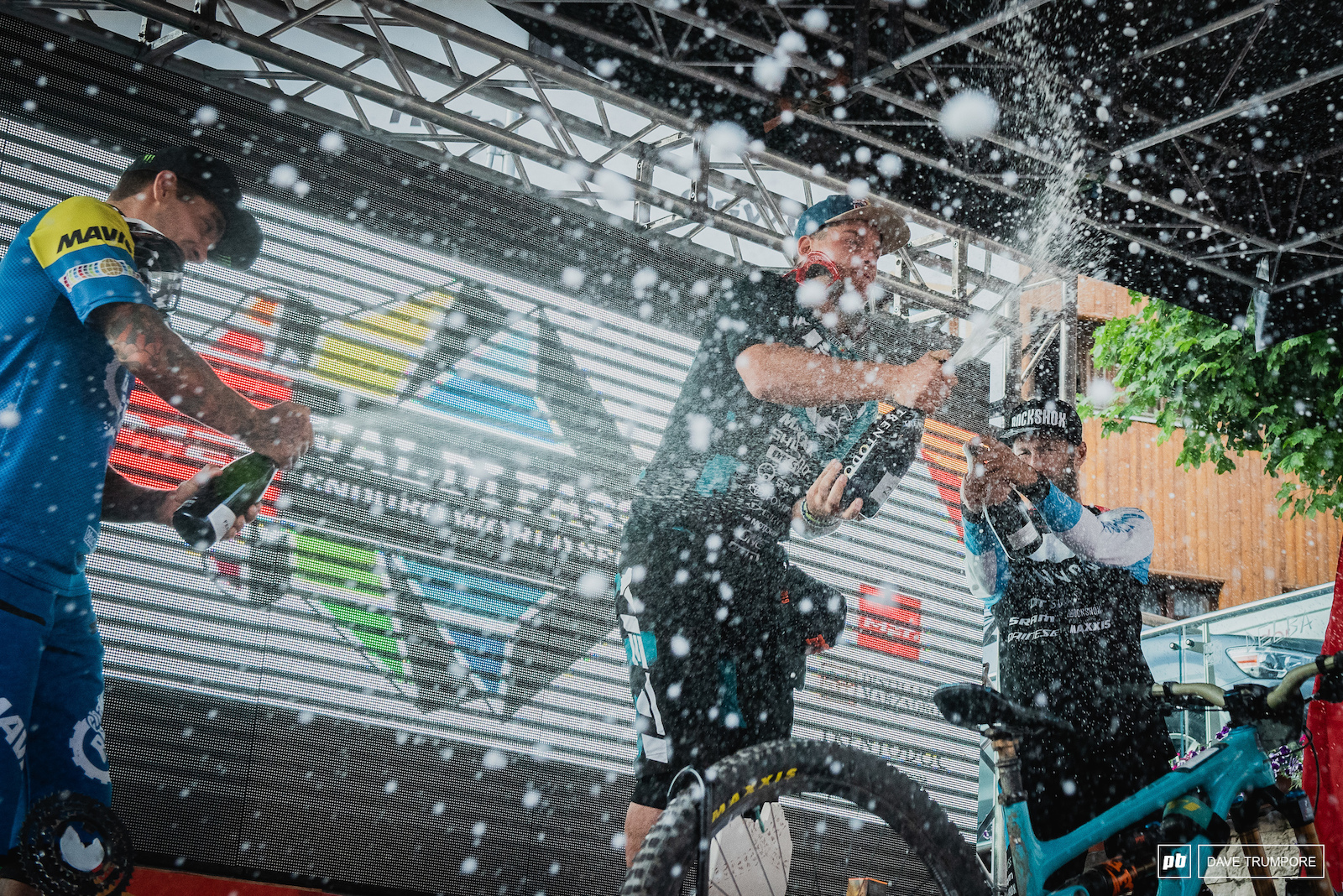 Richie Rude Sam Hill and Florian Nicolai pupping bottles on the podium.