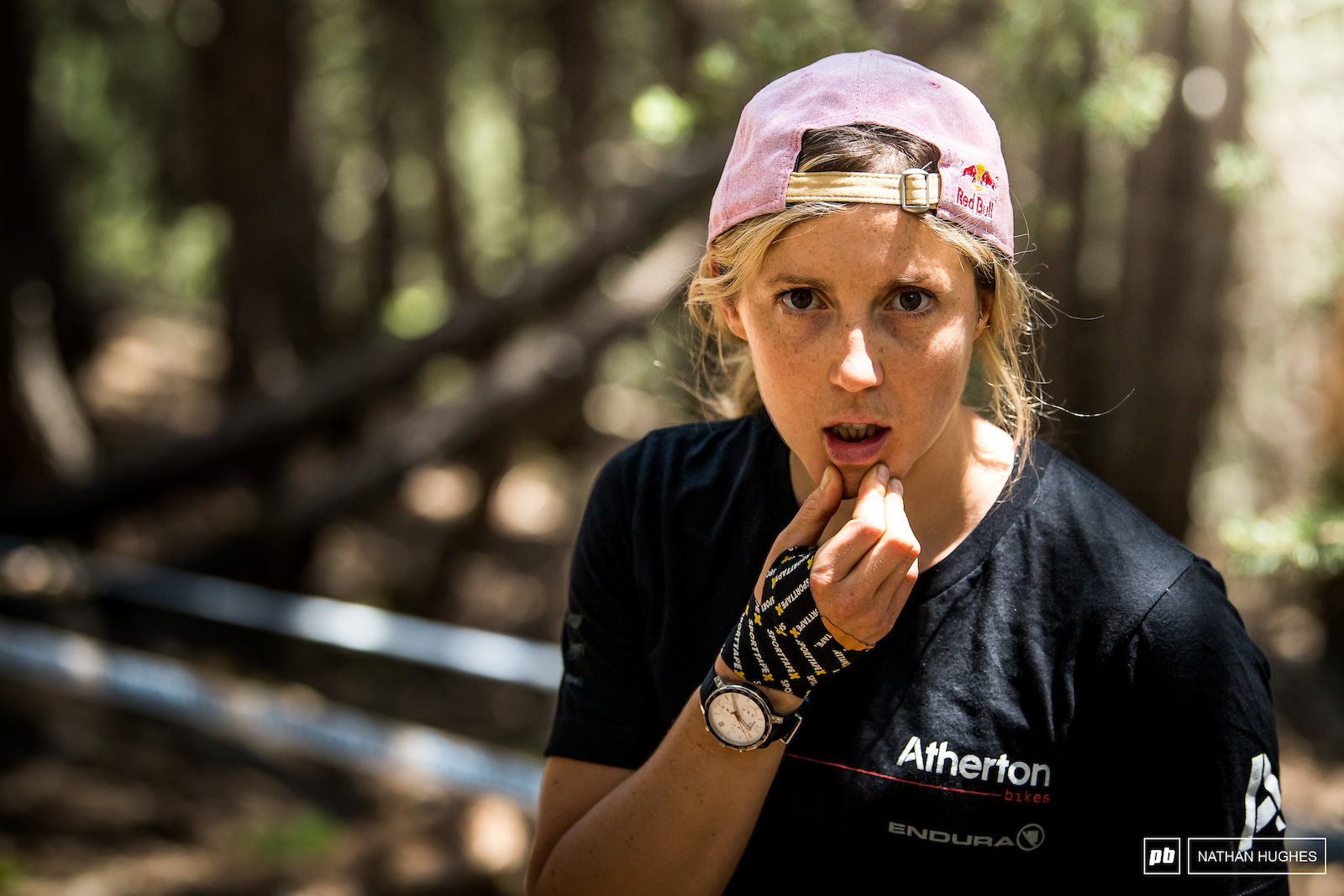 A taped hand and a look of line-choice induced fear from Rachel Atherton mid-track.