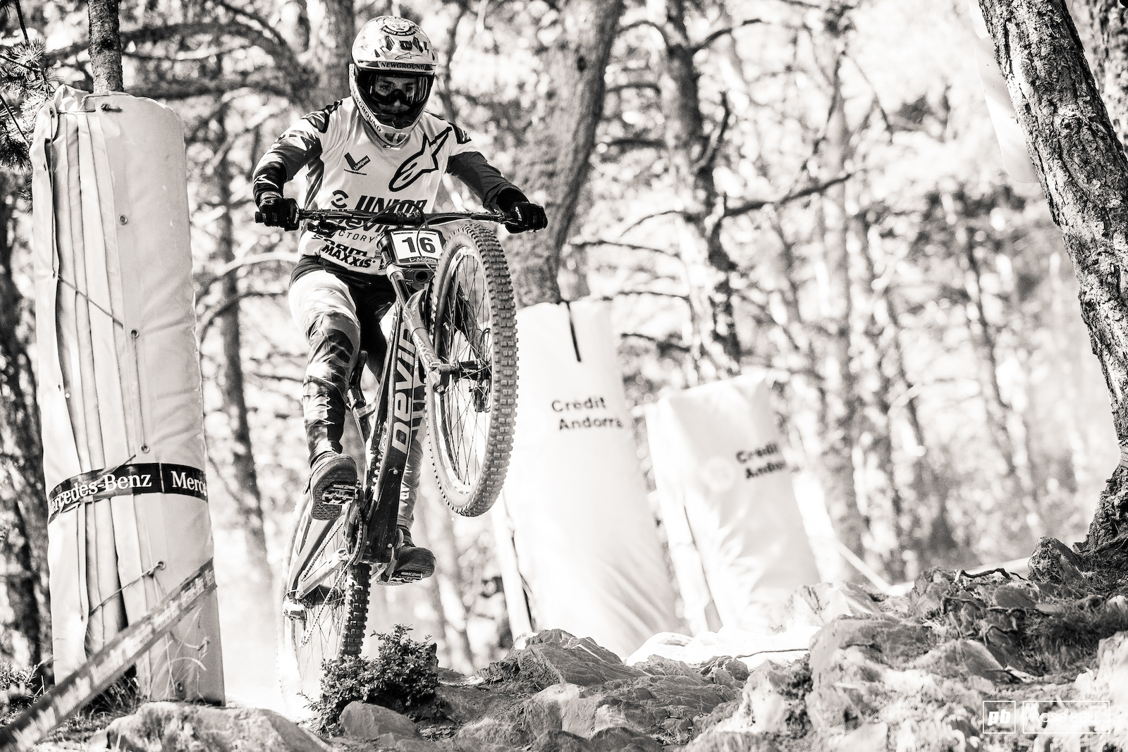 Dakotah Norton gapping out of the rock garden where riders have been puzzling over line choice all weekend.