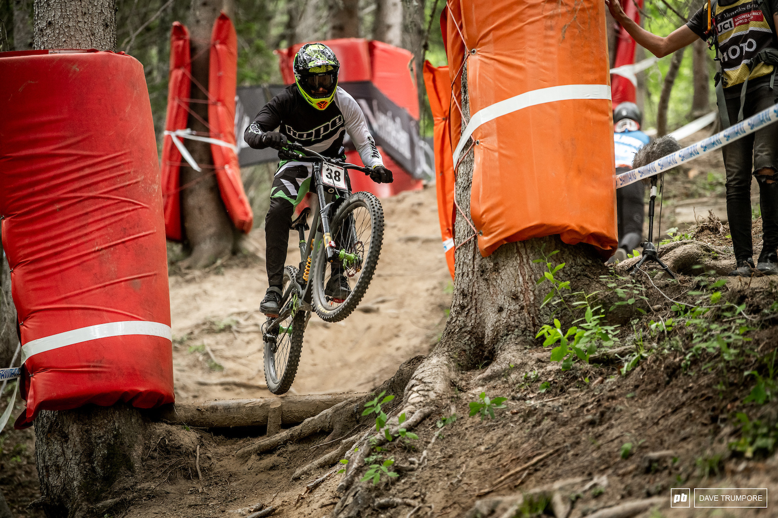Adam Brayton giving it a yank over the roots to setup on the off camber before dropping into a part pdf switchbacks.