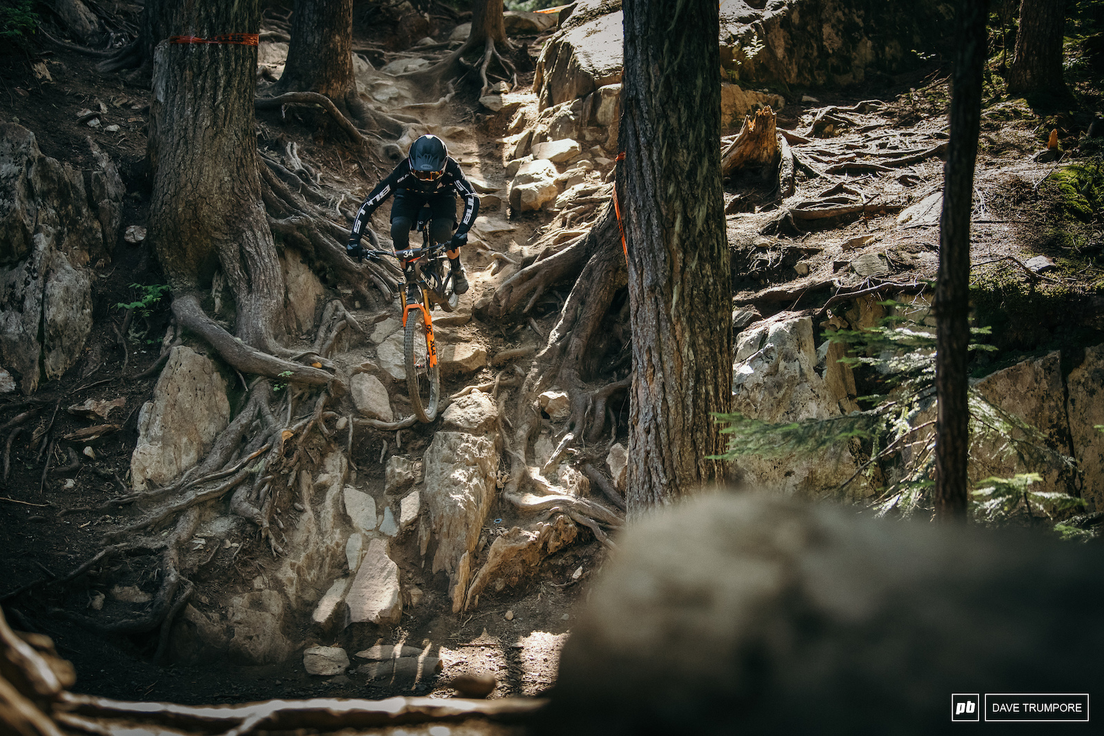 Usually it s DH bikes that we see smashing down through the classic rocks of In Deep during the annual Garbanzo DH race. This year however it is the Enduro World Series turn to show off what modern trail bikes are capable of.