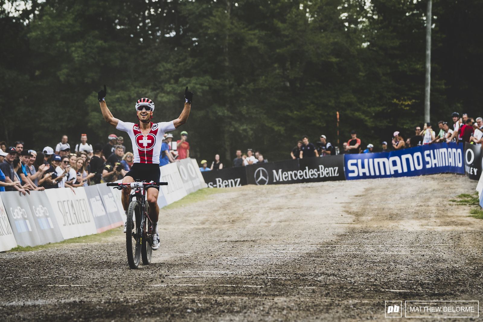 Nino Schurter brings the gold home for team Swiss.