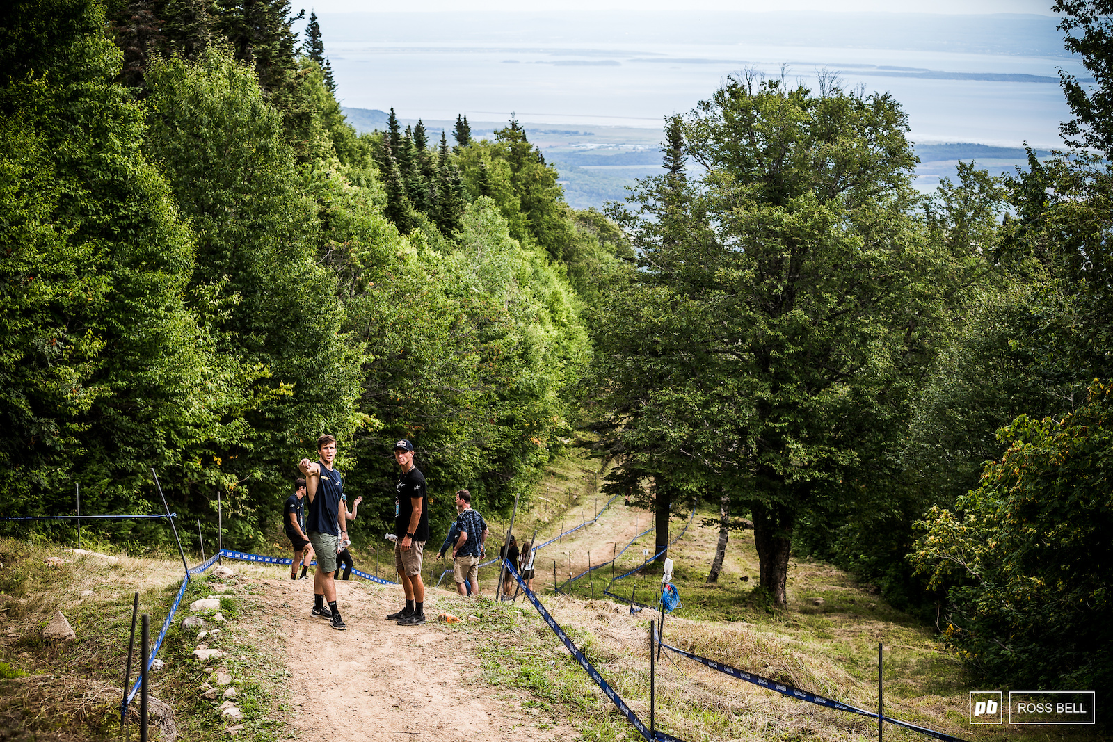 Martin Maes was back racing last weekend at the EWS now he is swinging a leg over a downhill bike once again. He inspects the first flat out straight with team mate George Brannigan.